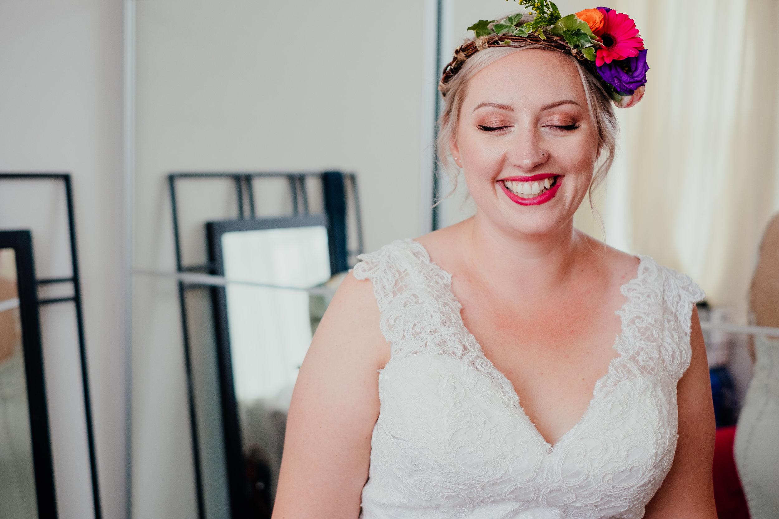Vegan bride wearing flower crown smiling