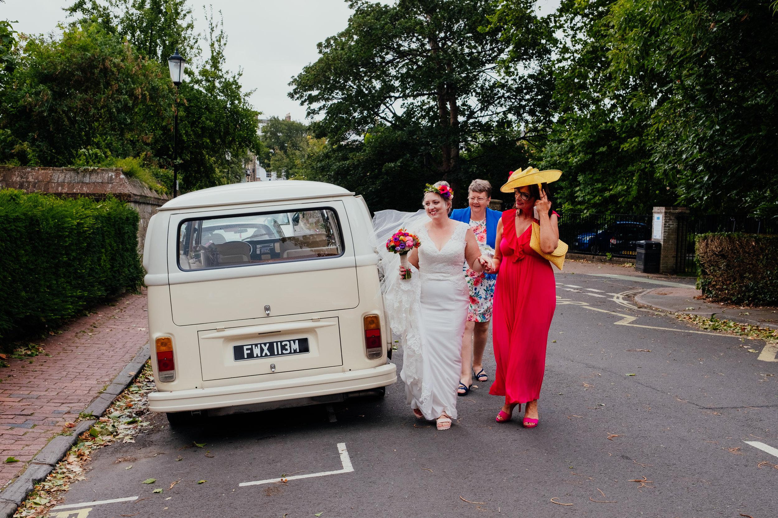 Vegan bride arrives at wedding in VW camper van