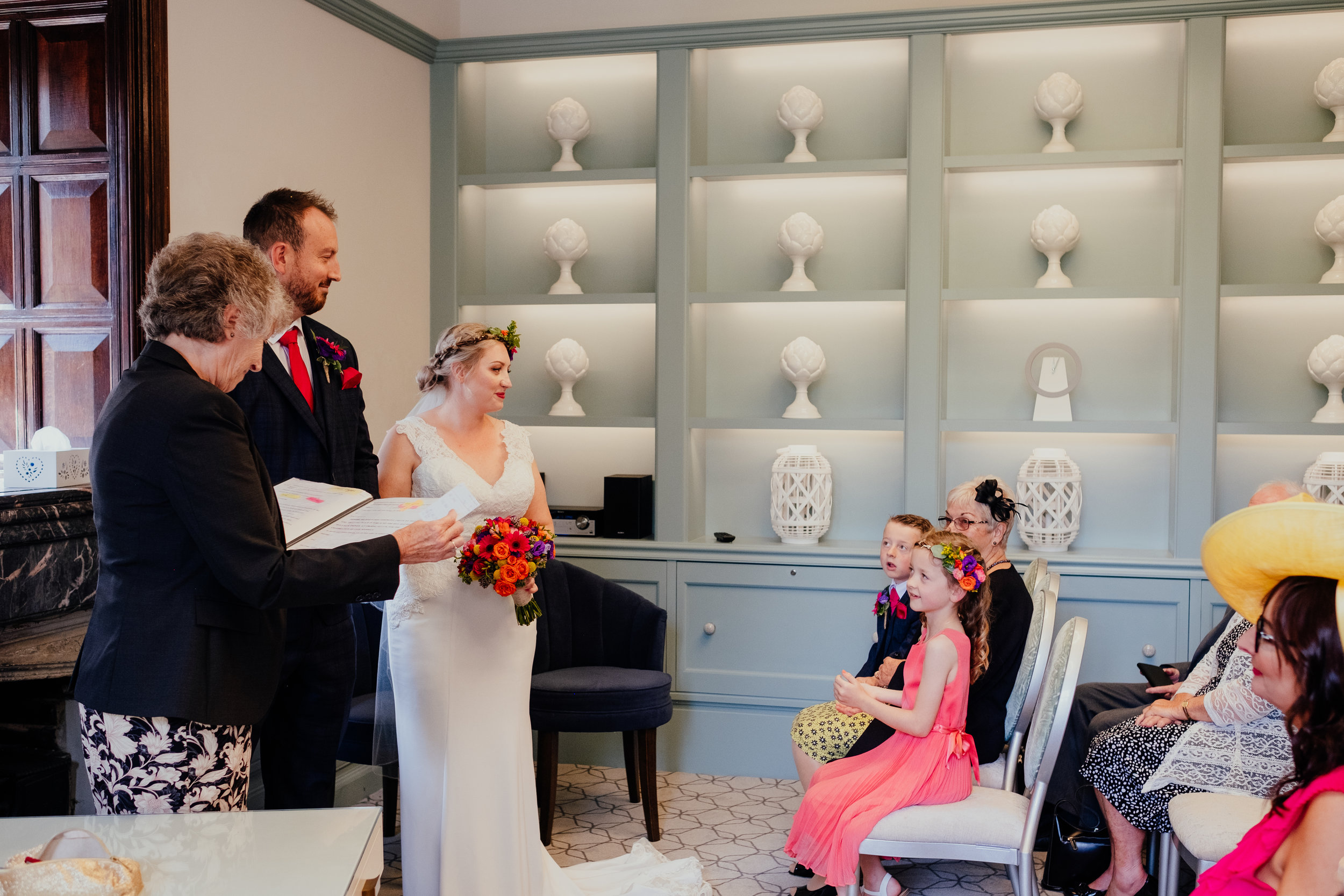 Wedding ceremony at Southover Grange in Lewes | Bride and Groom smile at their children