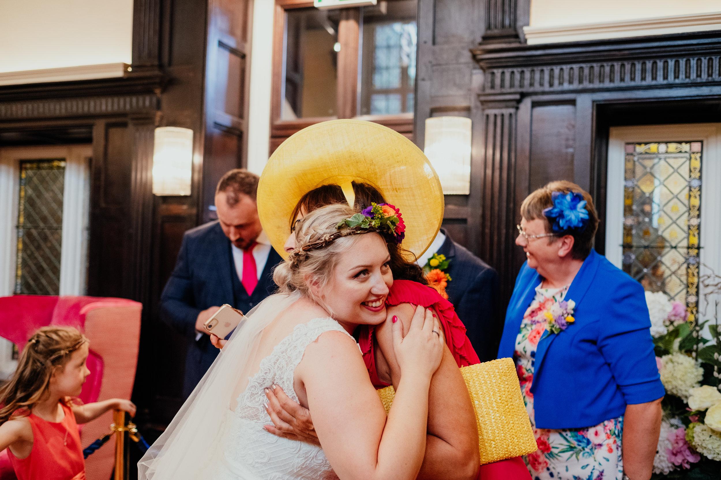 Vegan bride hugs her mum after wedding ceremony