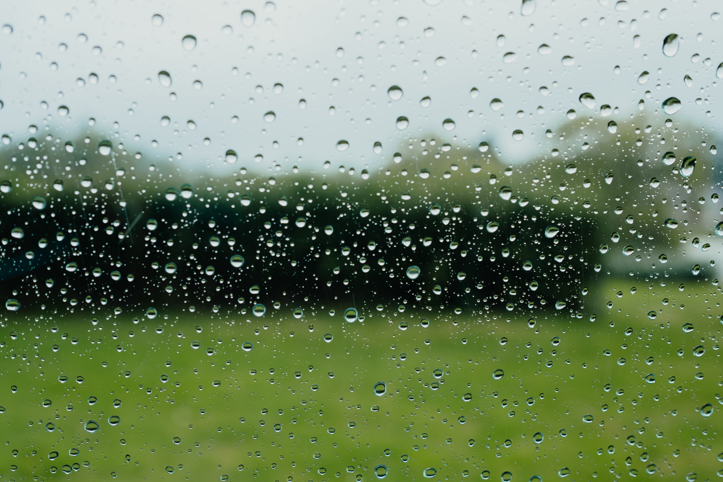 Rainy wedding in East Sussex | raindrops on car window