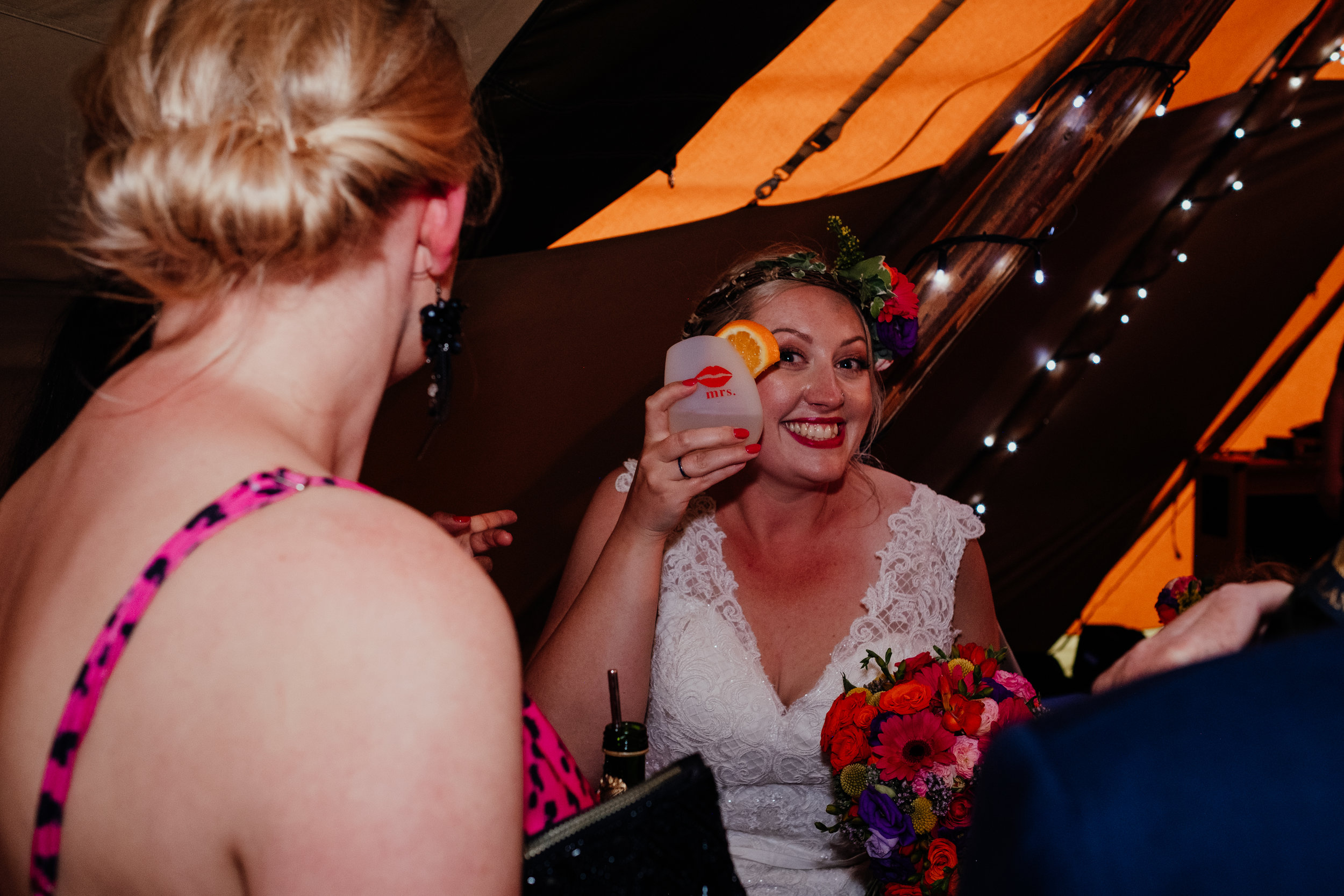 Bride drinks out of cup with 'mrs' on the side