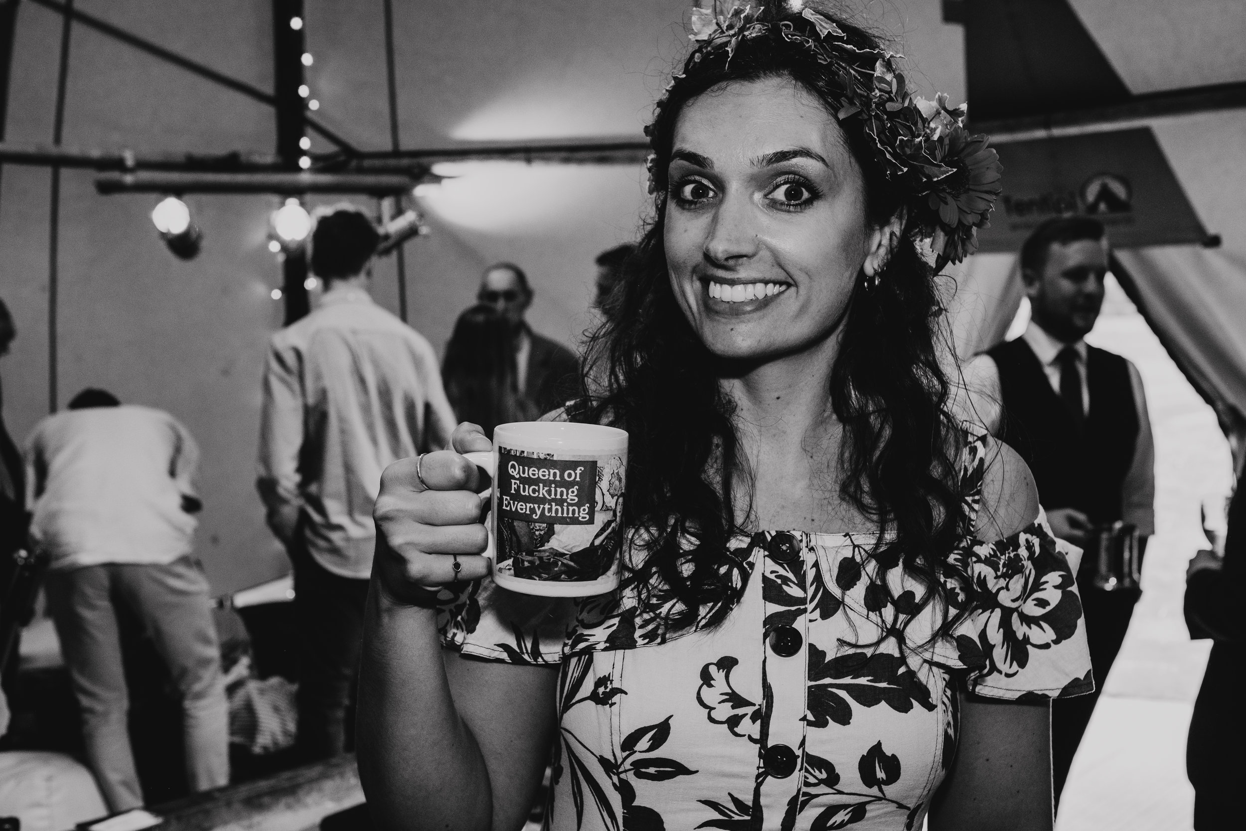 Bridesmaid holding 'Queen of Fucking Everything' mug