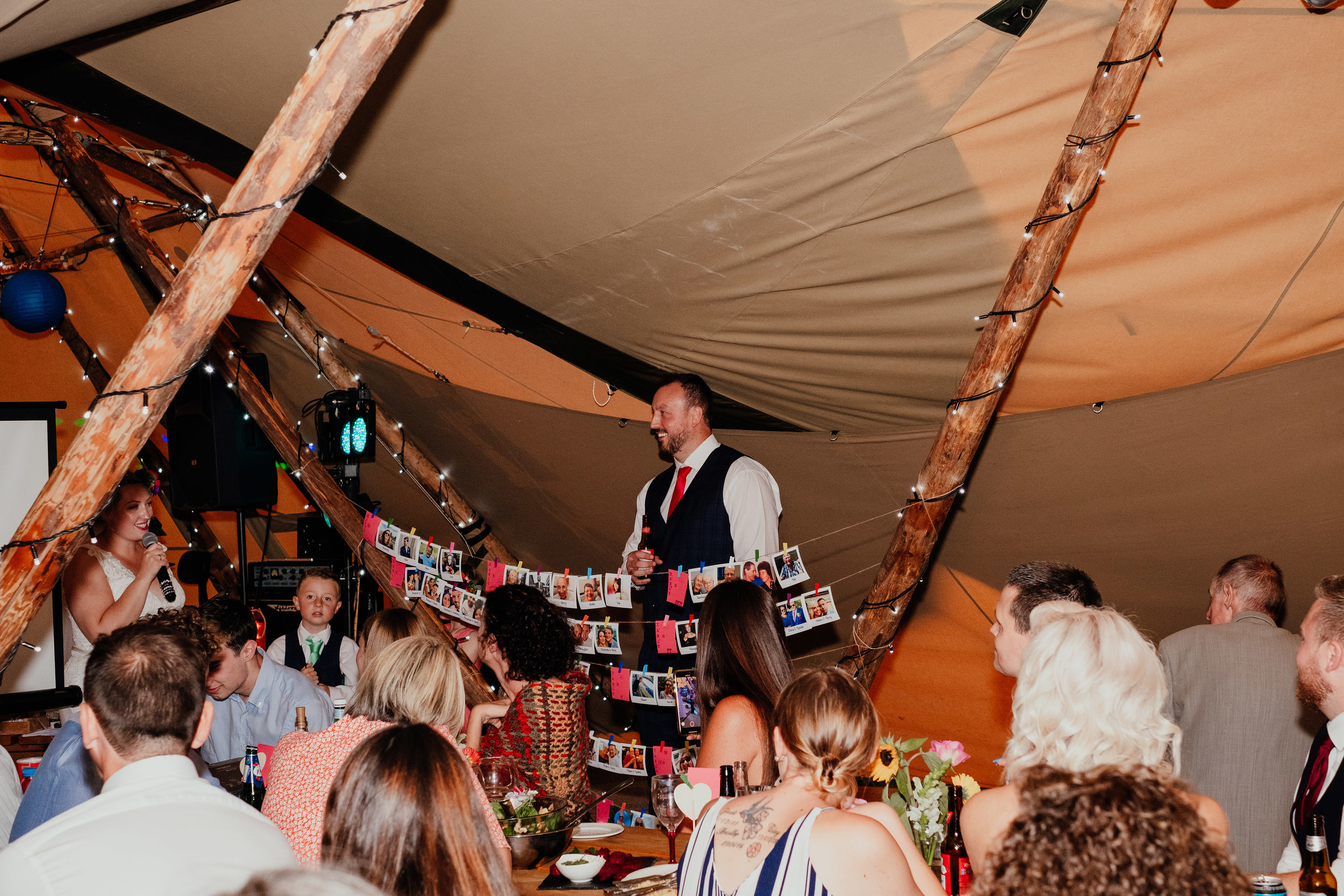 Bride gives speech during tipi wedding