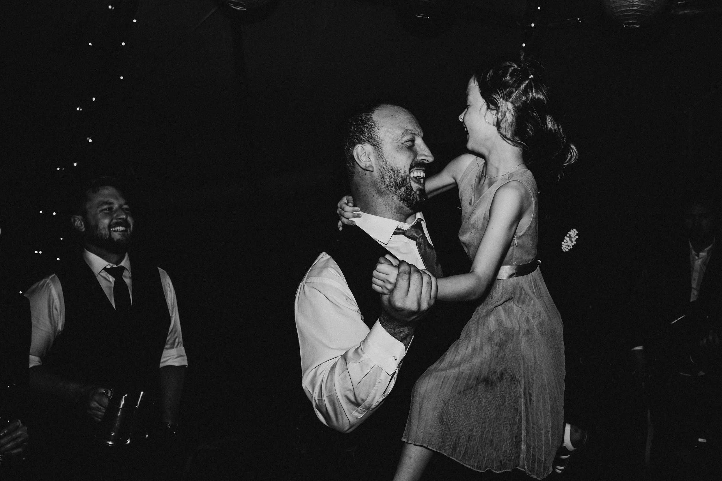 Groom dances with daughter during tipi wedding