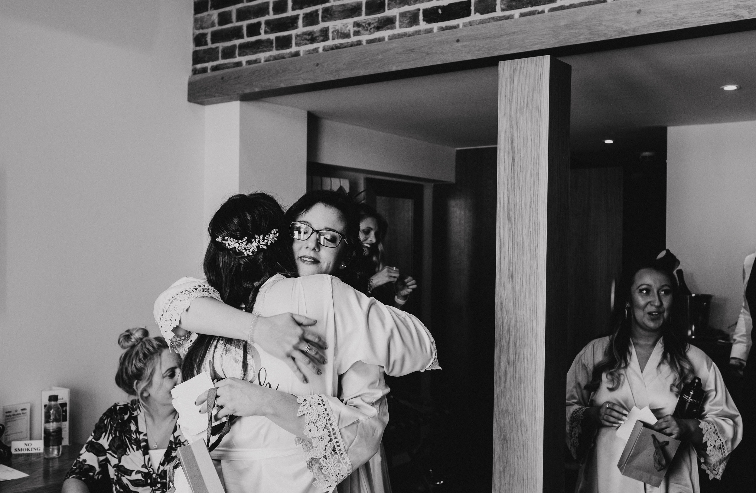 Bride hugs her sister on the morning of the wedding