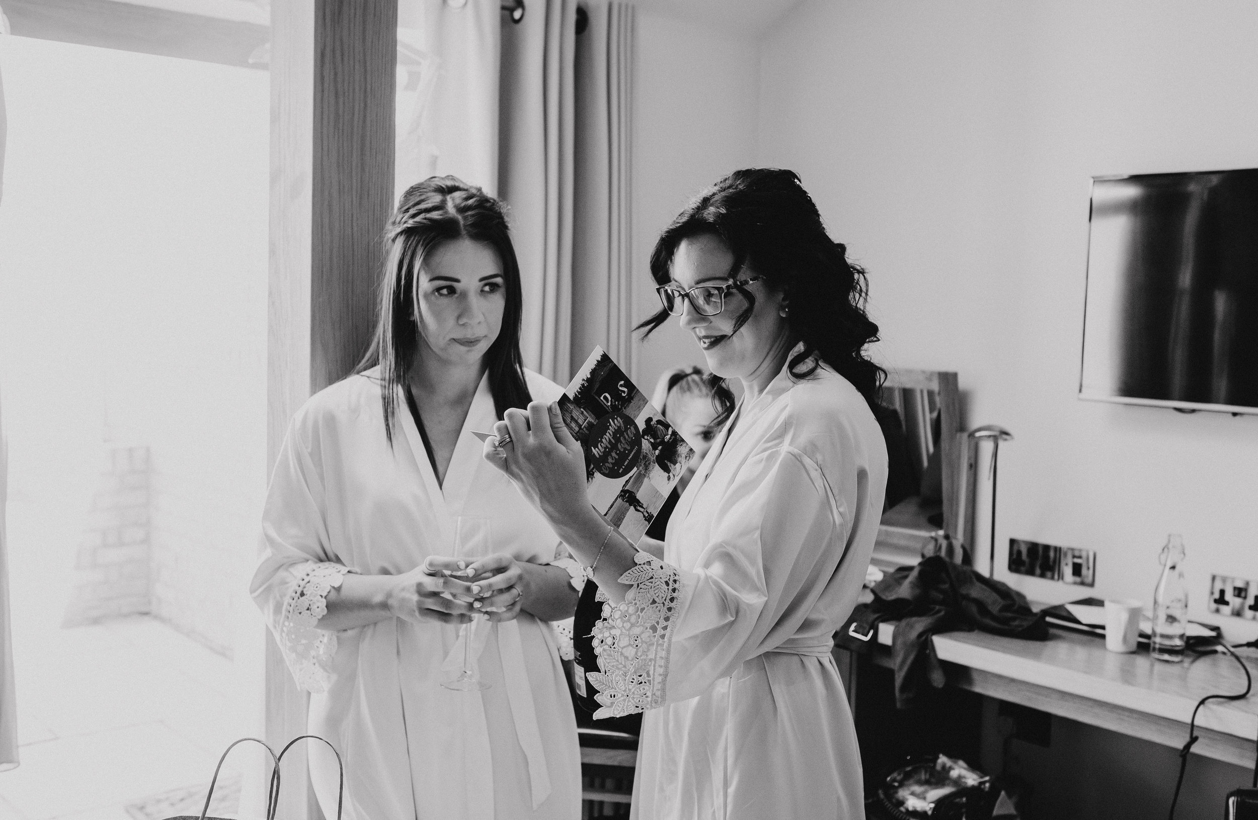 Bride and her sister read card