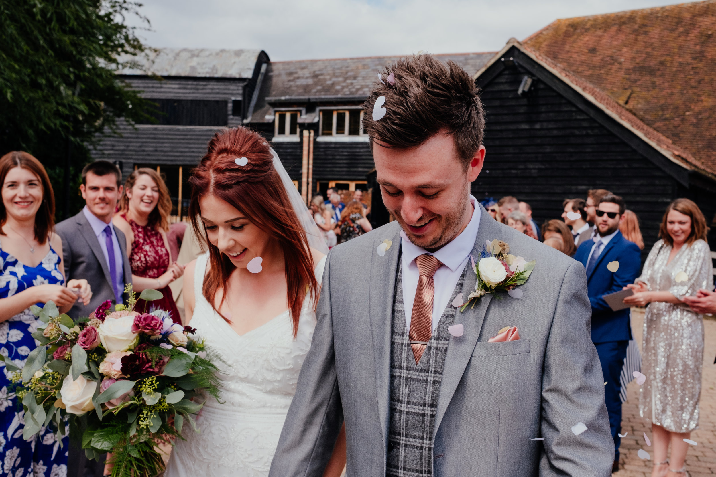 Happy Bride and Groom surrounded by heart confetti