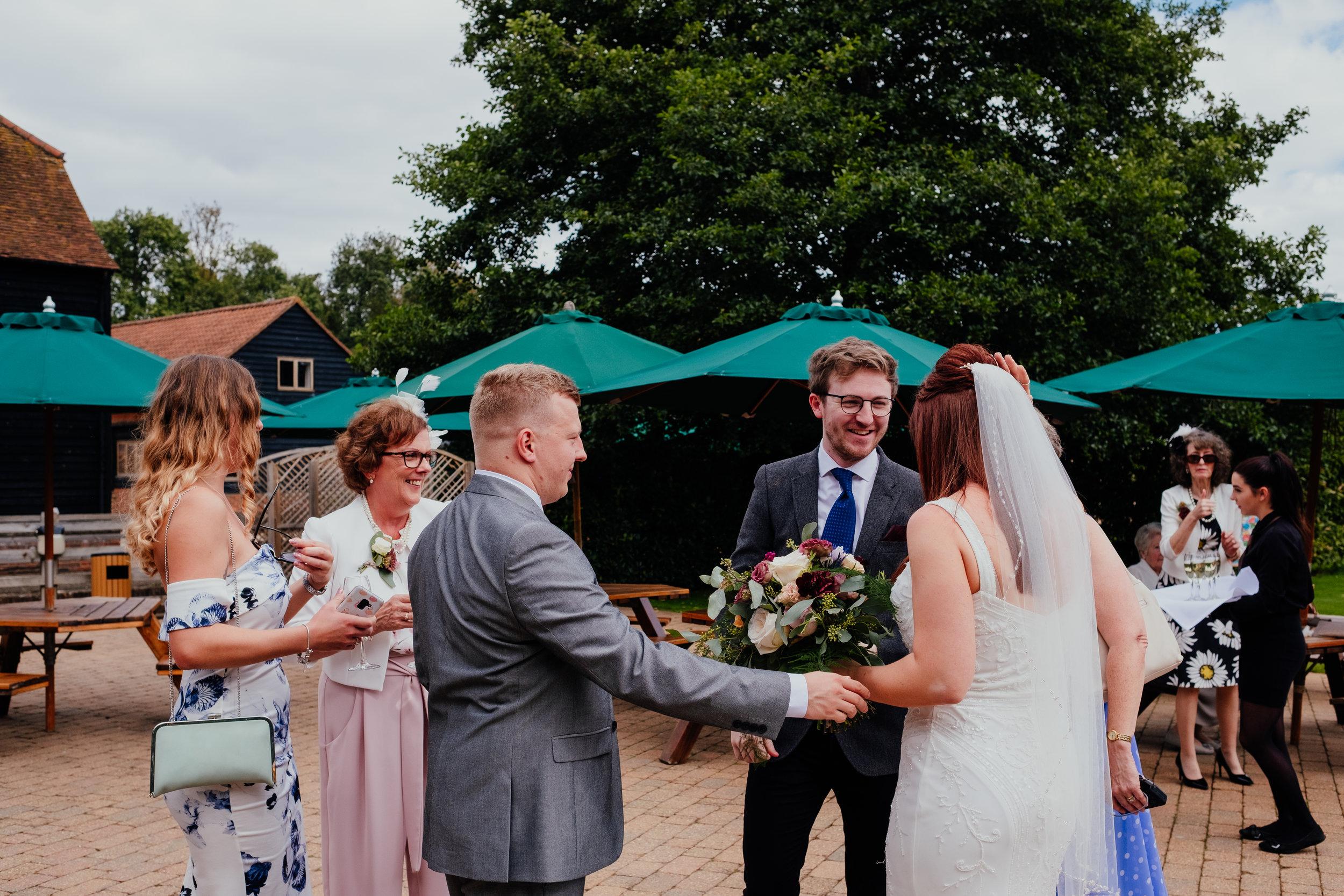 Wedding guests greet bride at wedding