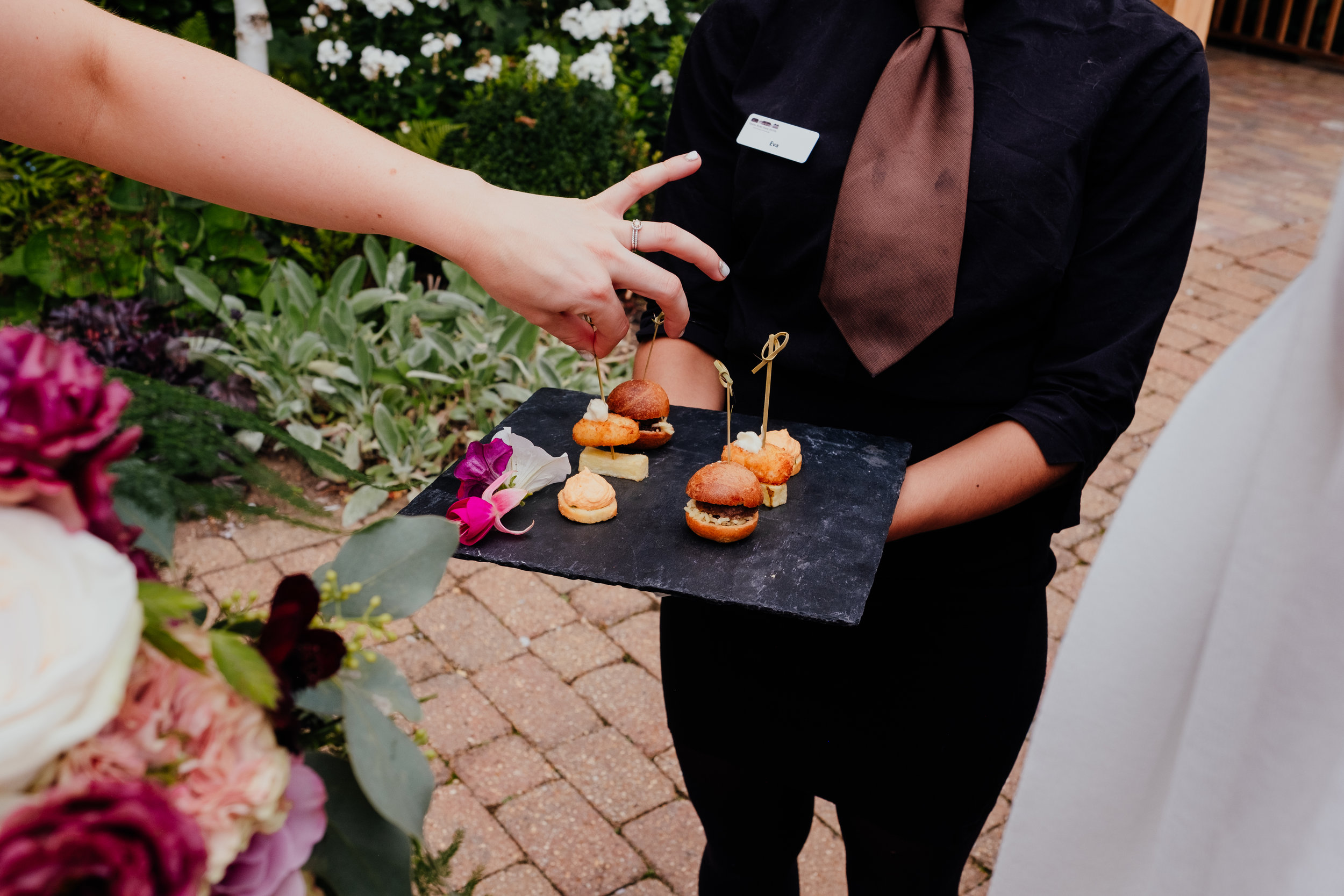 Bride reaches for canapés