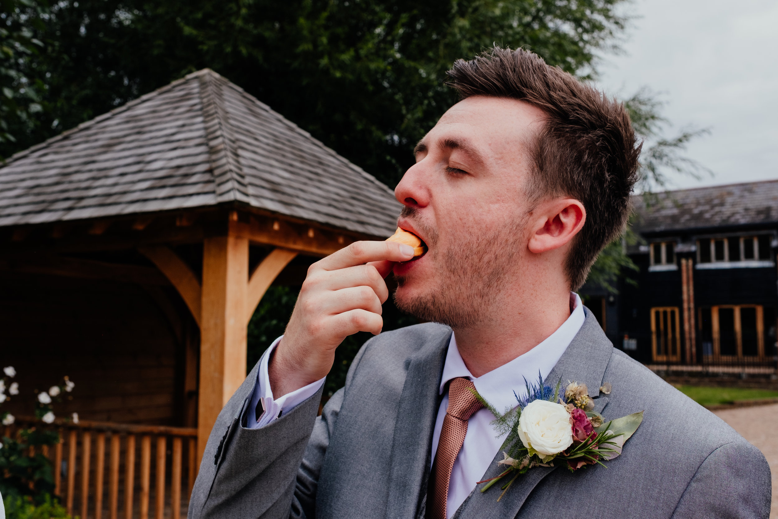 Groom eating canapés