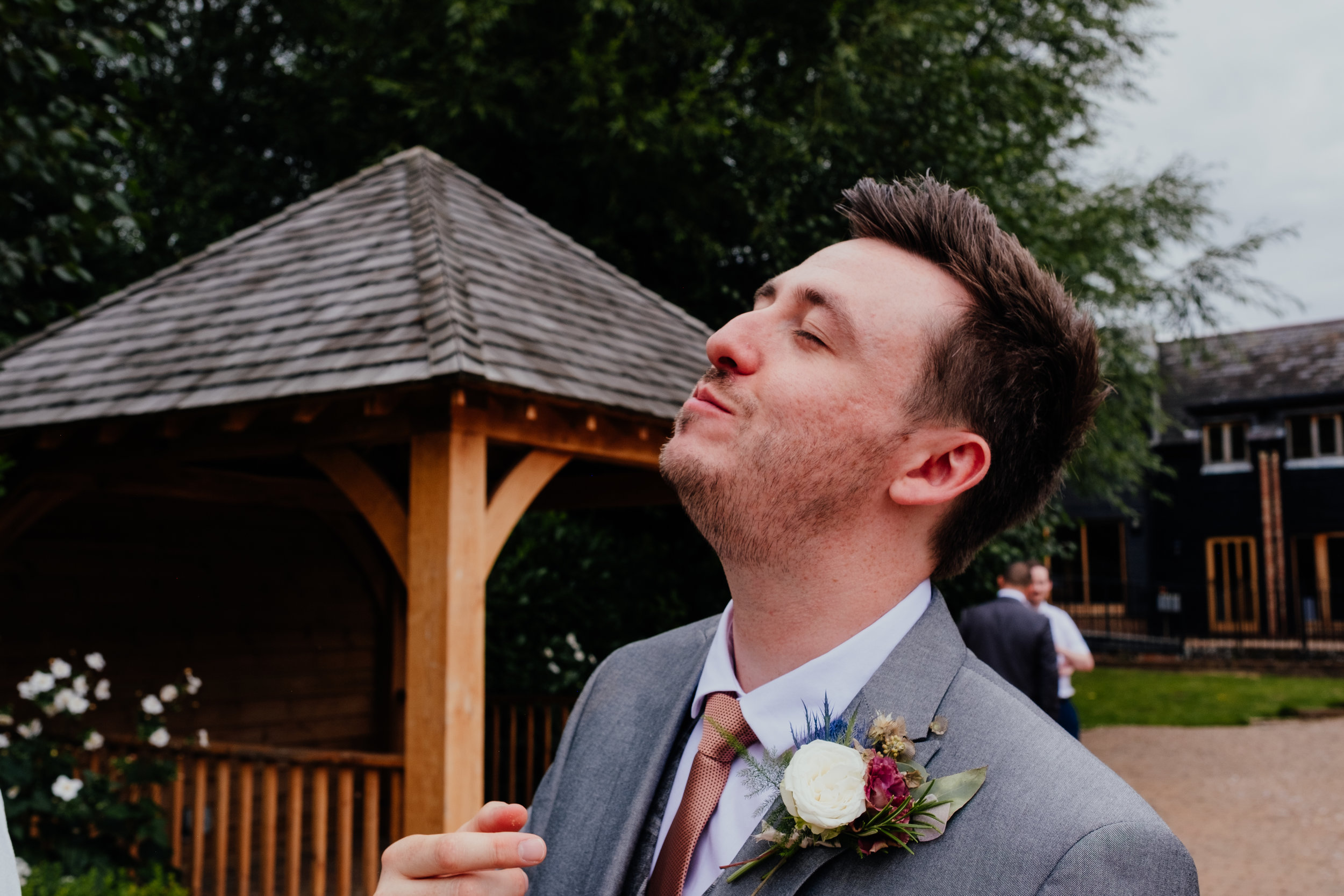 Groom enjoying canapés