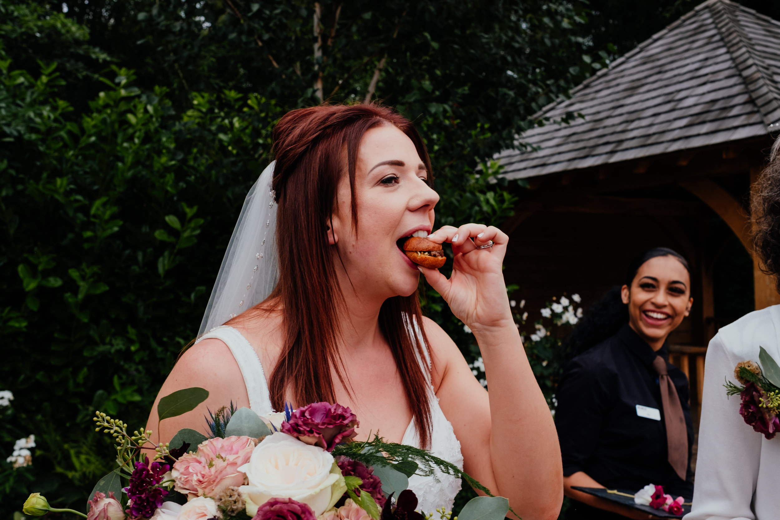 Bride eating burger
