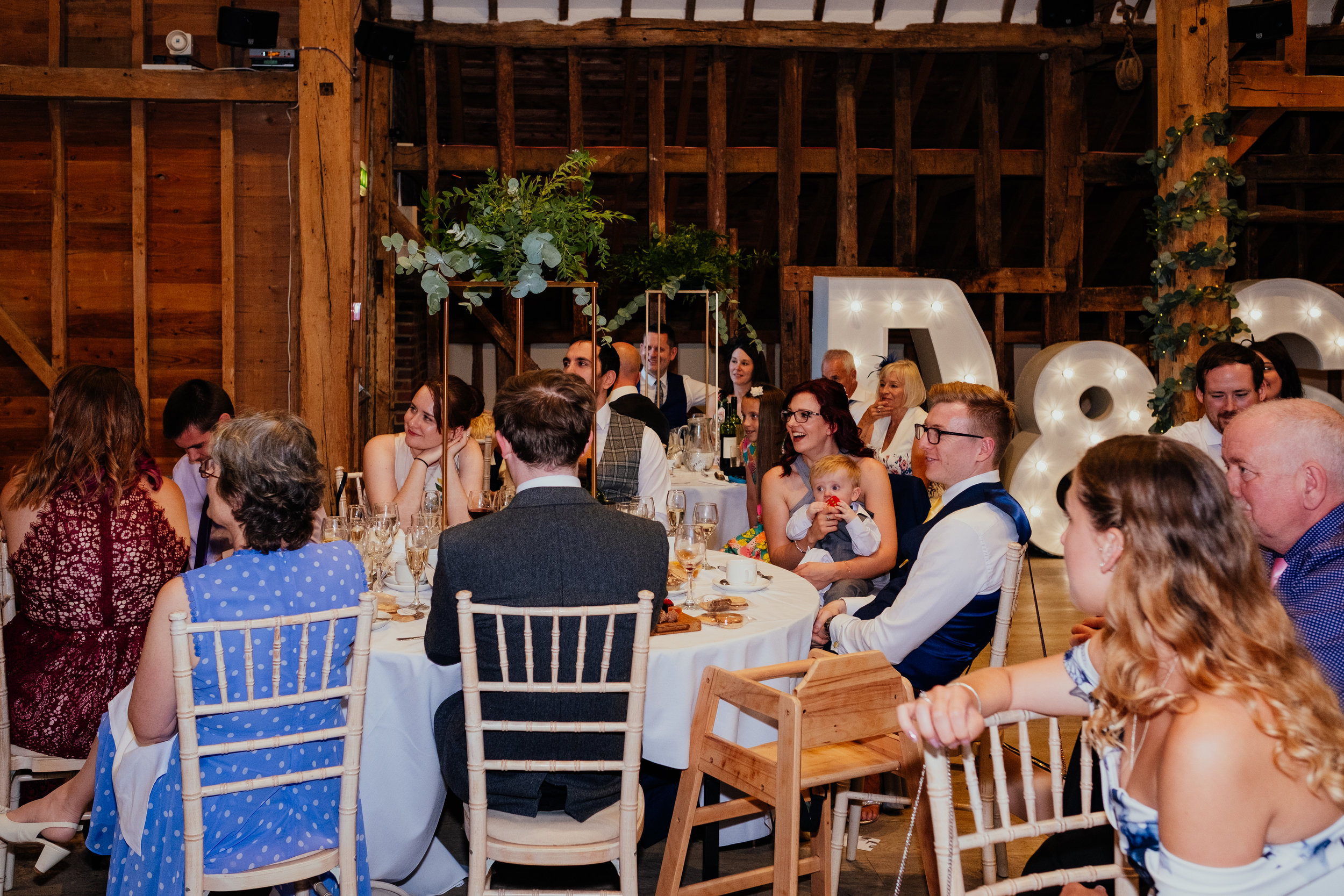 Wedding guests laugh during speeches