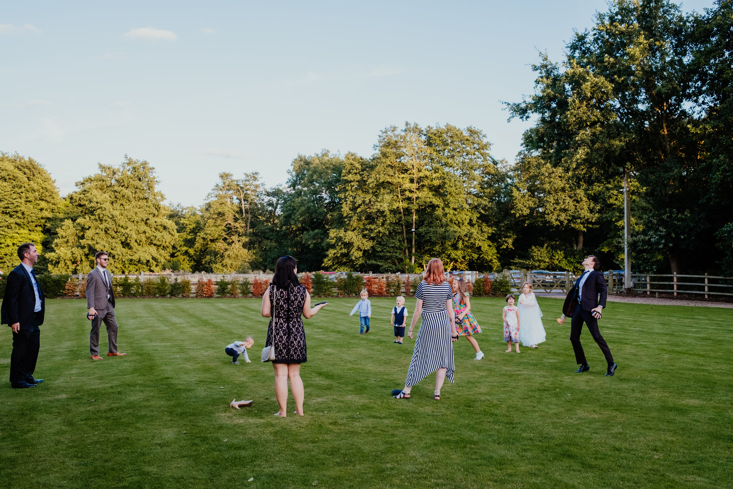 Wedding guests playing games outside