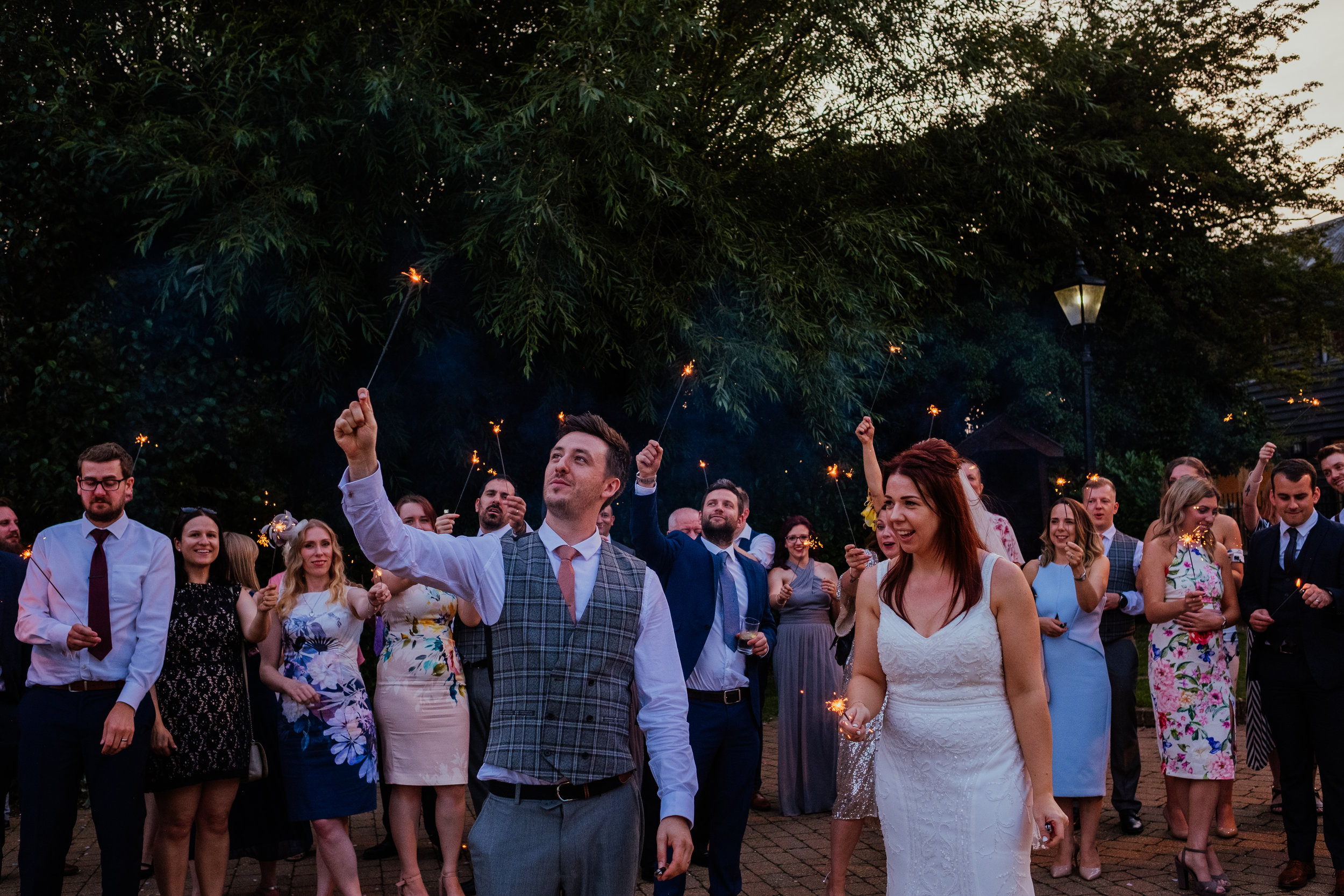 Sparklers during sunset at Tewin Bury Farm wedding