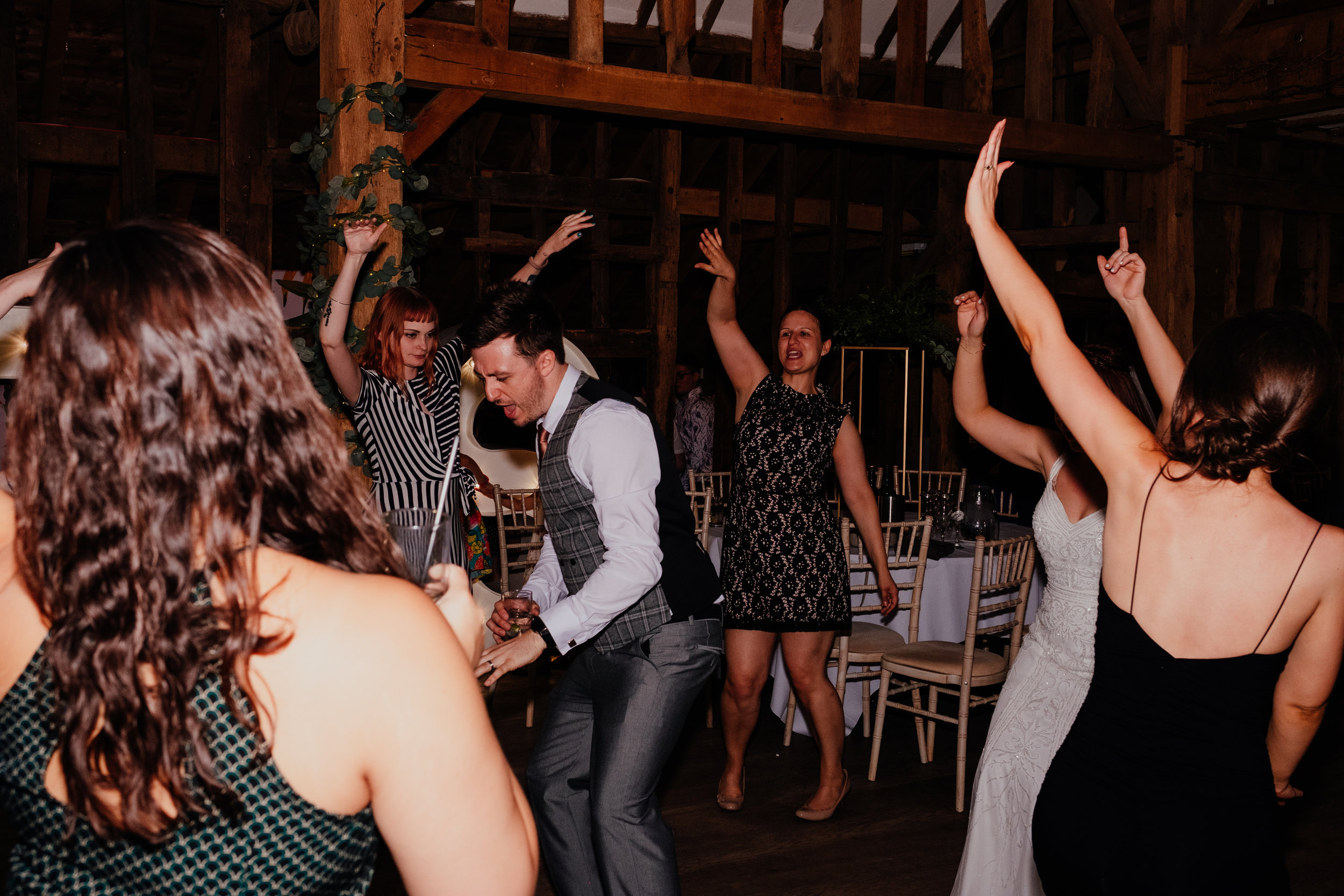 Bride and groom dancing with guests at Tewin Bury Farm wedding