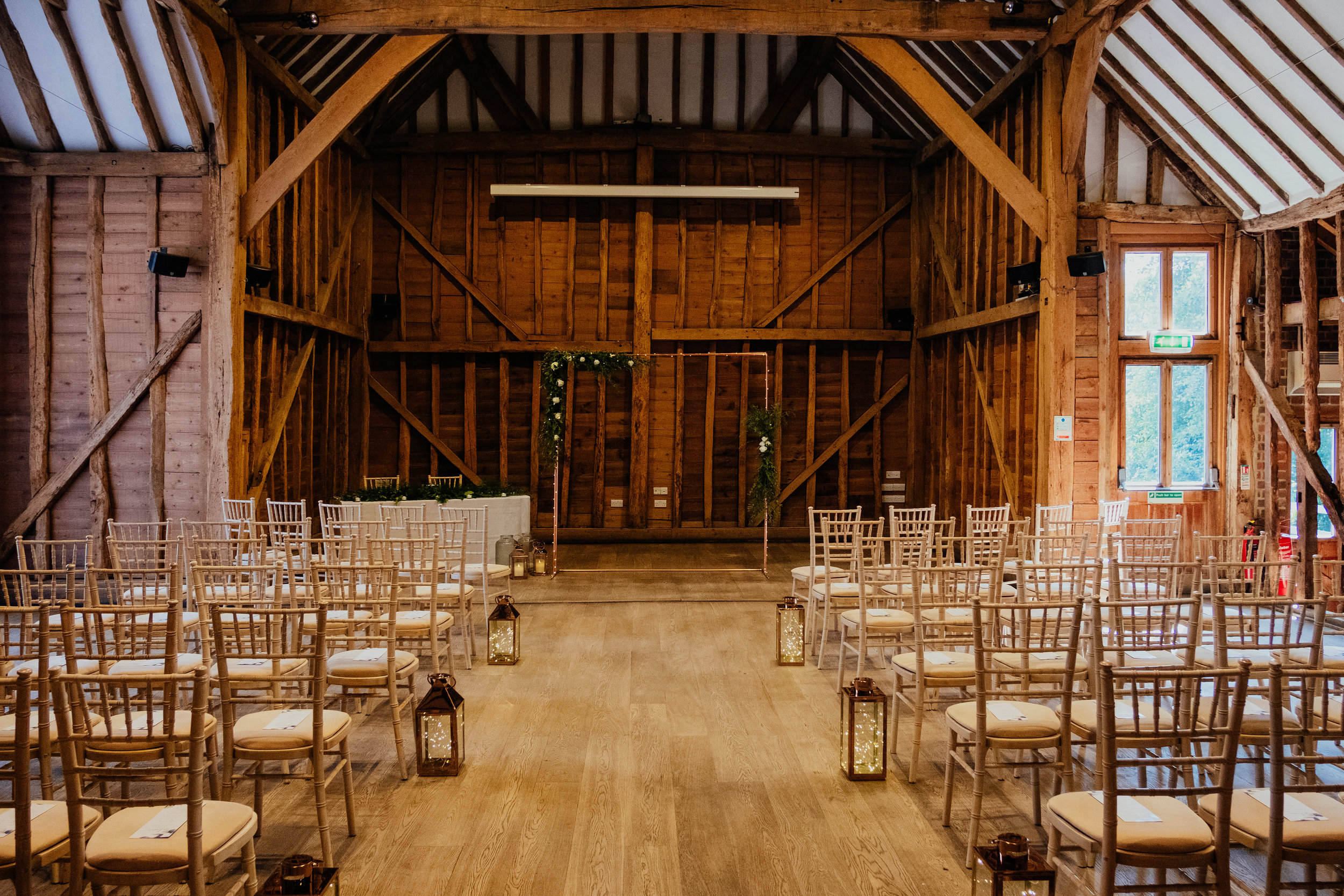 Tewin Bury Farm wedding ceremony in Tythe Barn