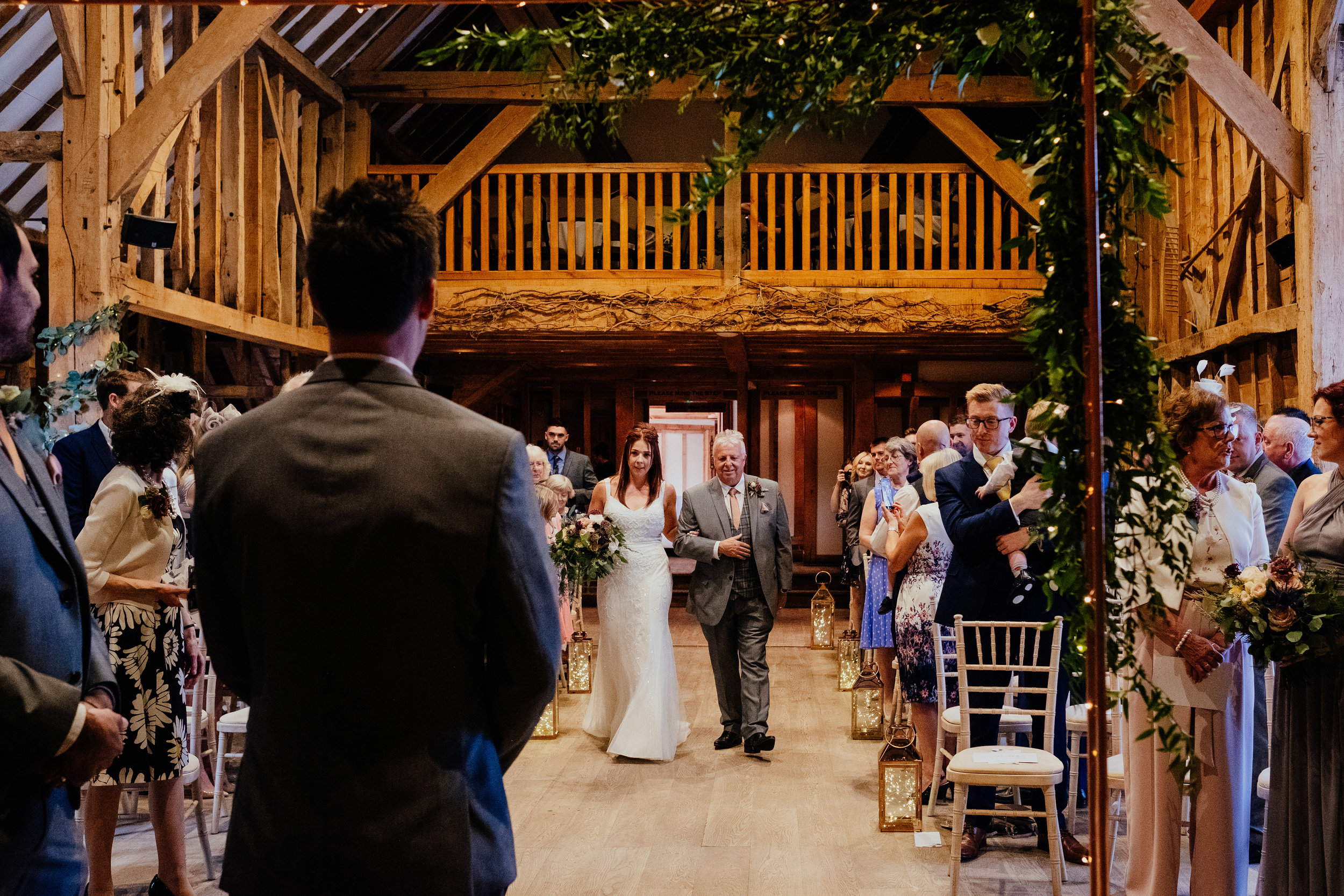 Bride and her dad walk down the aisle at Tewin Bury Farm wedding