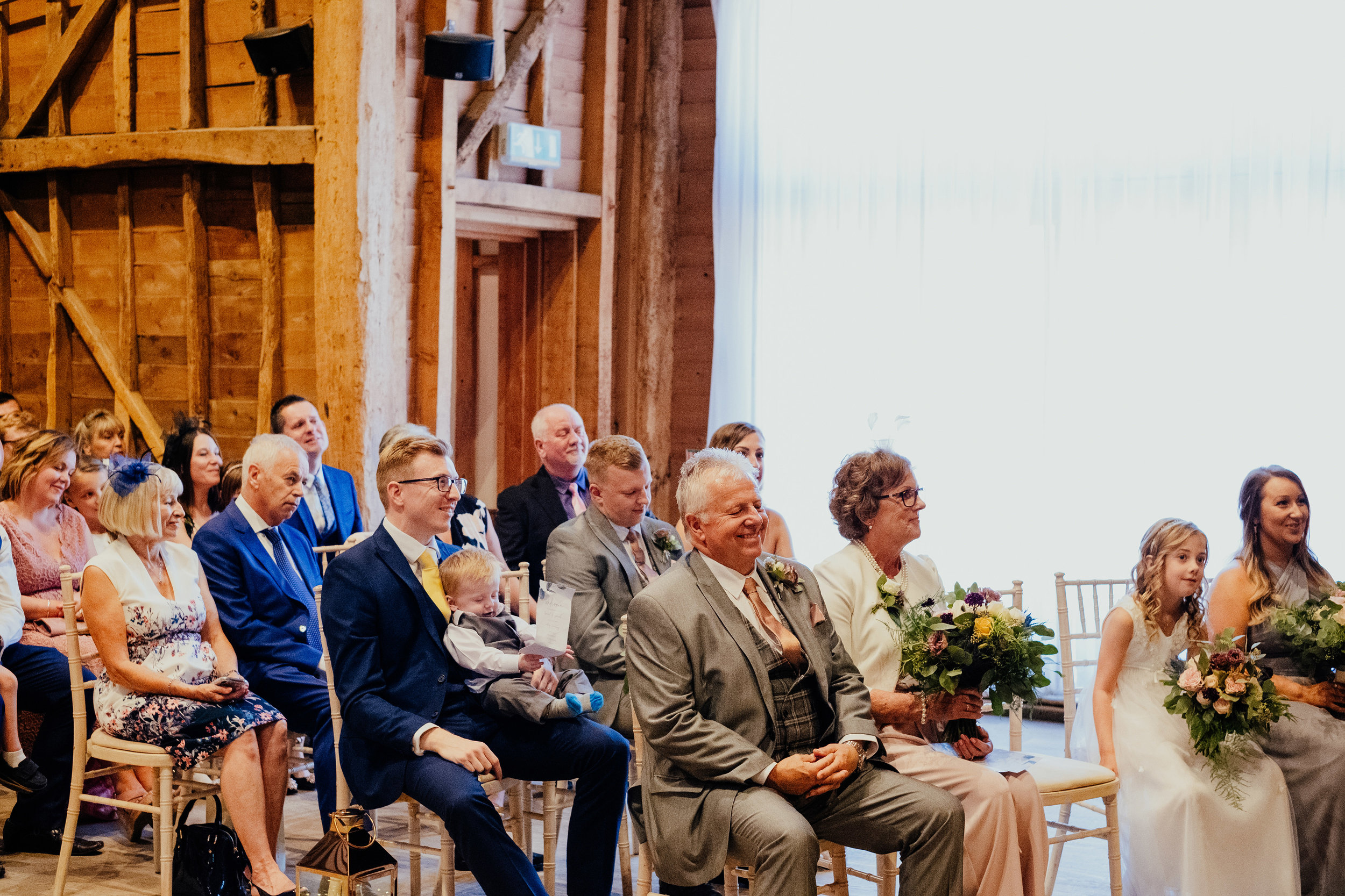 Wedding guests smiling during reading