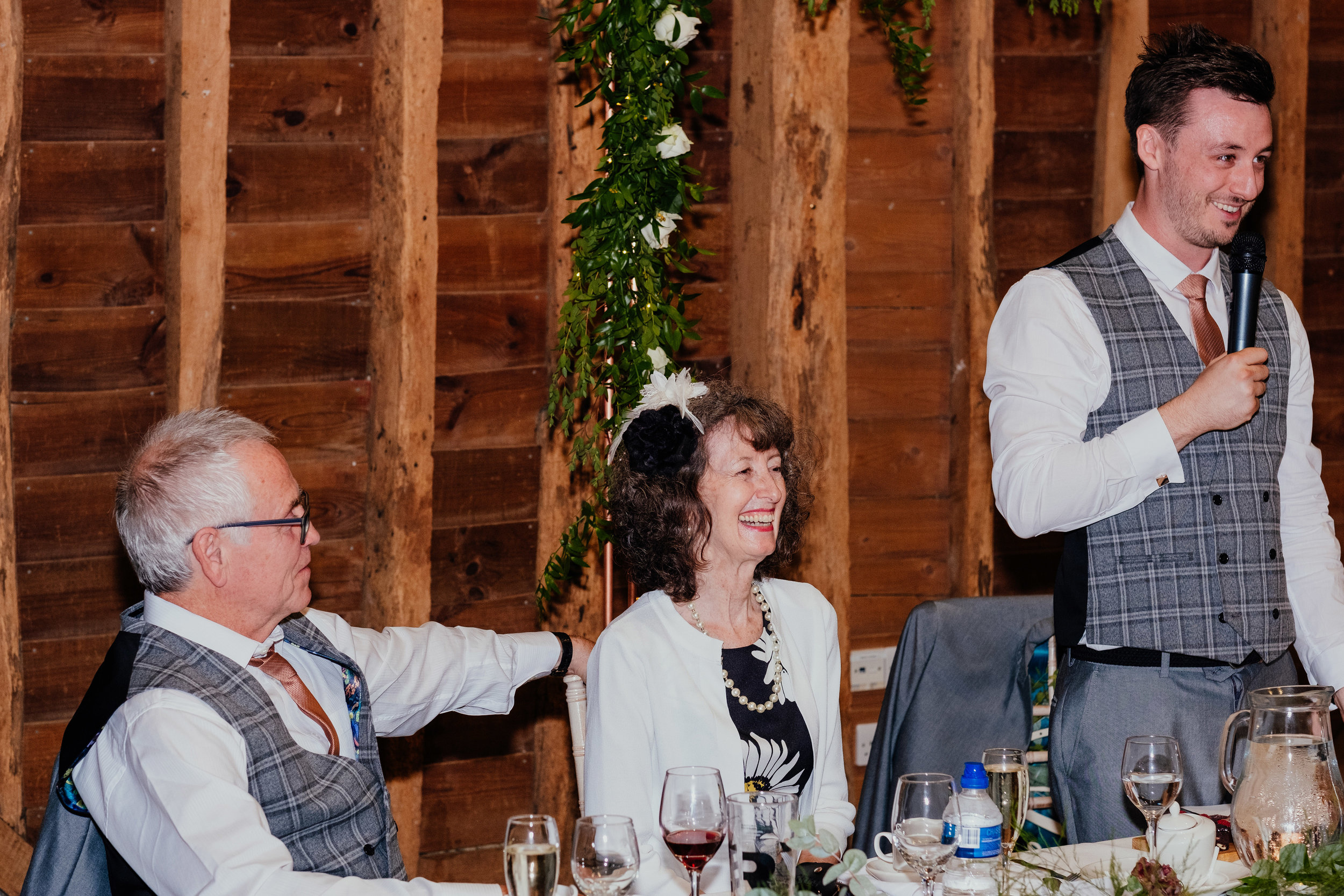 Groom's family laughs as he gives wedding speech
