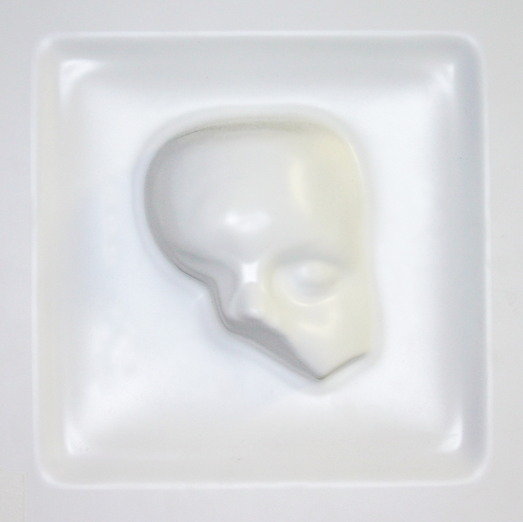 "Vacuum Formed Self Portrait    –     12""x12"" plastic extrusion created by taking a 3D facial scan, rendering it's mesh in Maya, CNC'ing that mesh into plaster and then vacuum forming plastic over that mold."