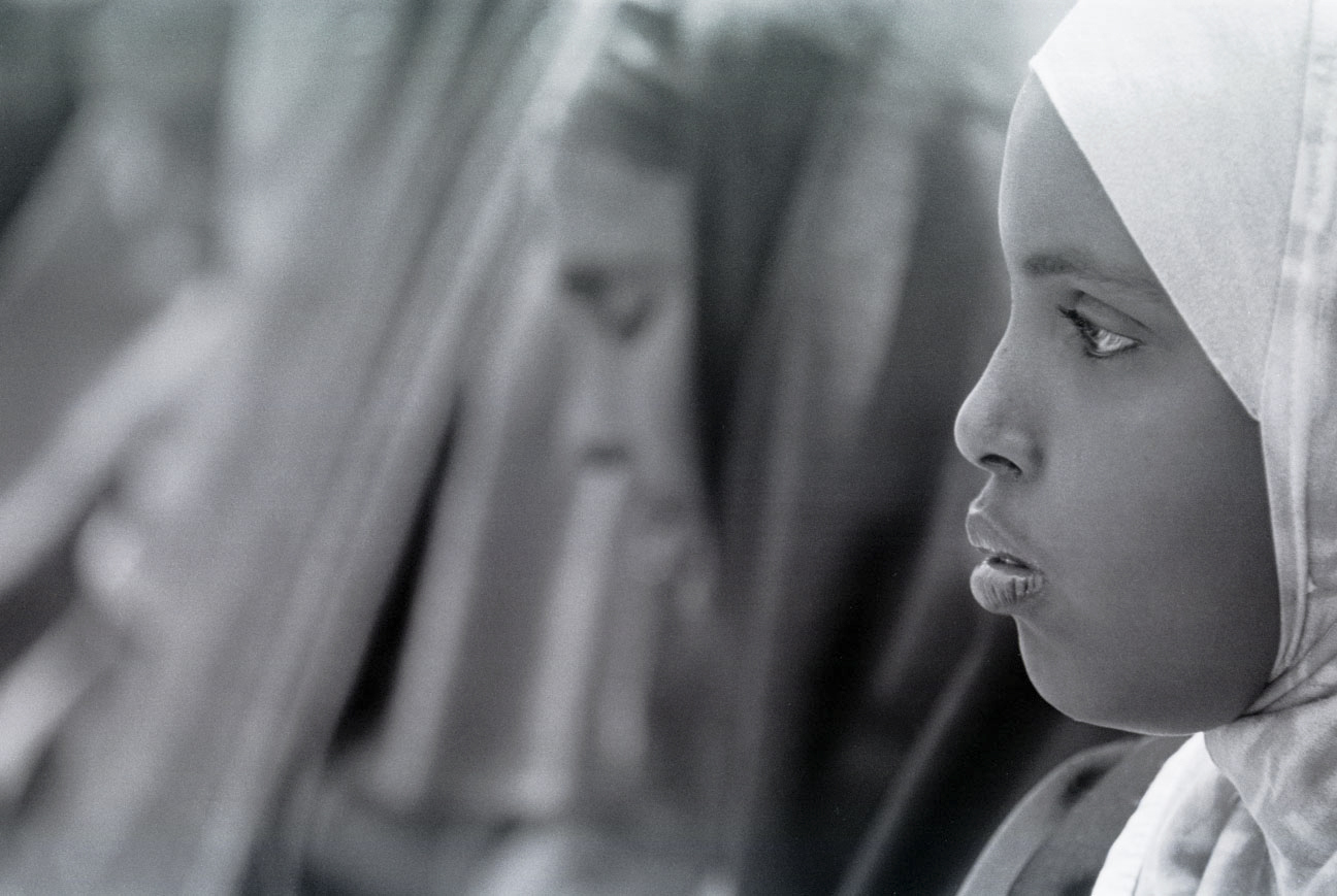 The daughter of a detained Somali American leader stands in protest with other women in San Diego in 2003.