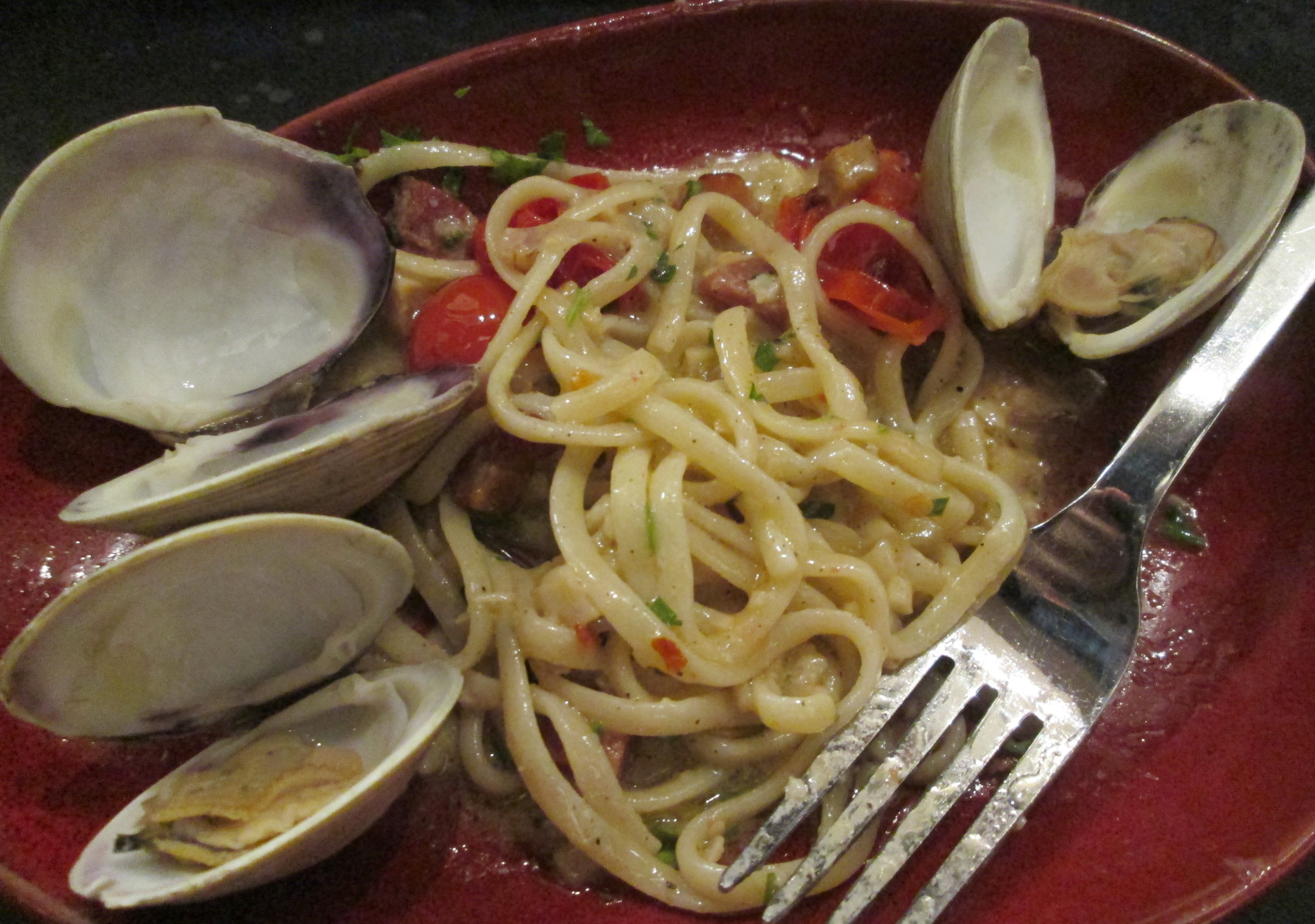 Half-eaten linguine and clams