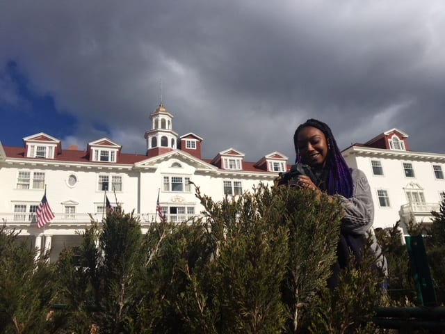 """Lauryn in the hotel's """"hedge maze."""" It was installed in 2015, so it's rather...tiny. For reference, Lauryn is 5'2."""