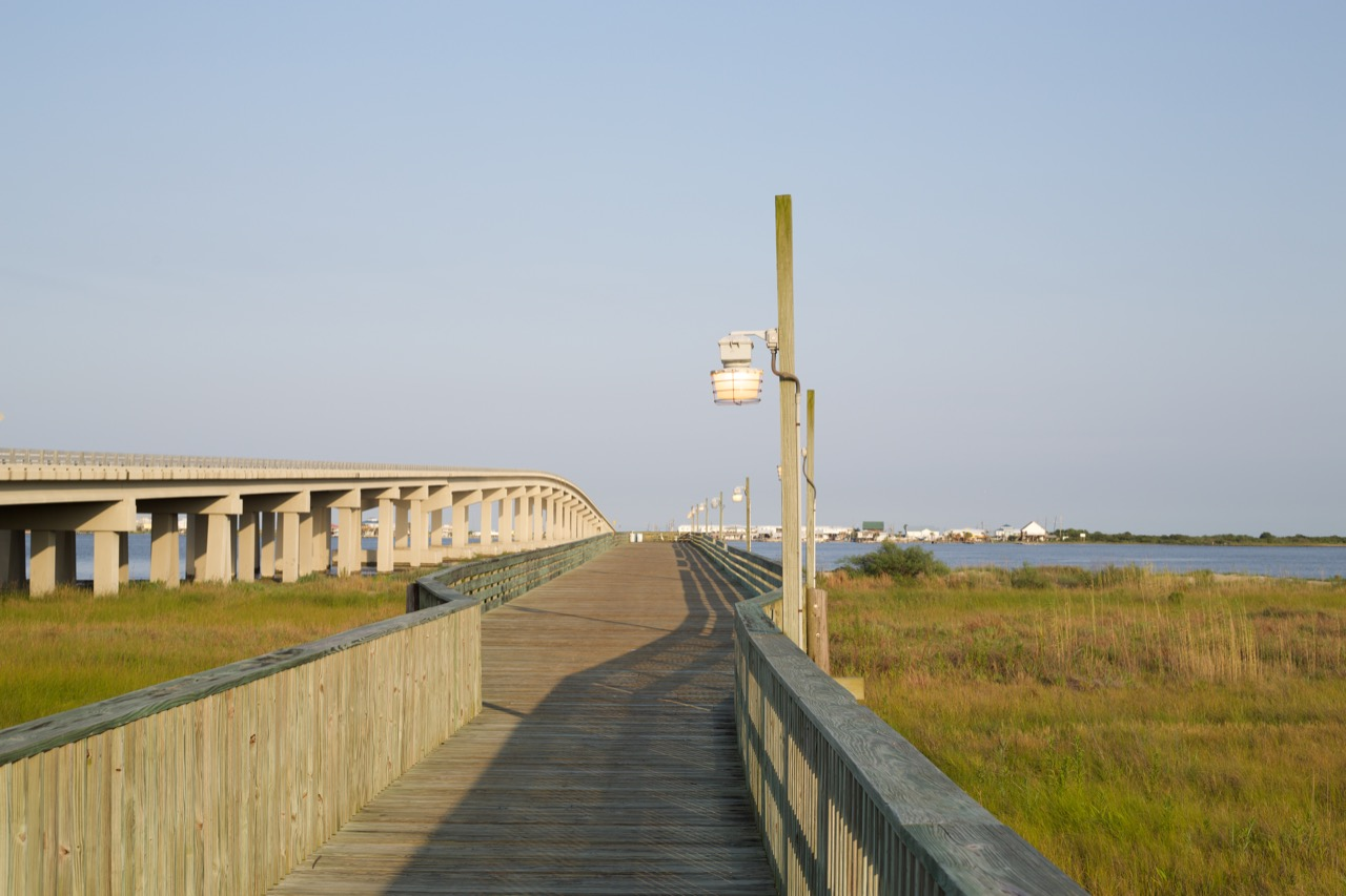 Pier view of the bridge crossing to Grand Isle