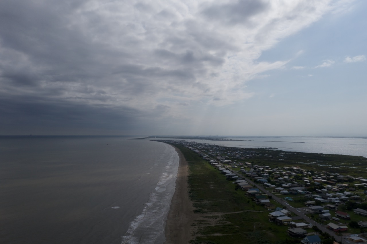 Grand Isle divided by storm and sunshine. The islands dark and mysterious past is overshadowed by the holiday fun