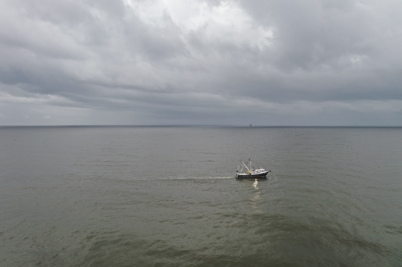 Boat juxtaposed with the coming storm