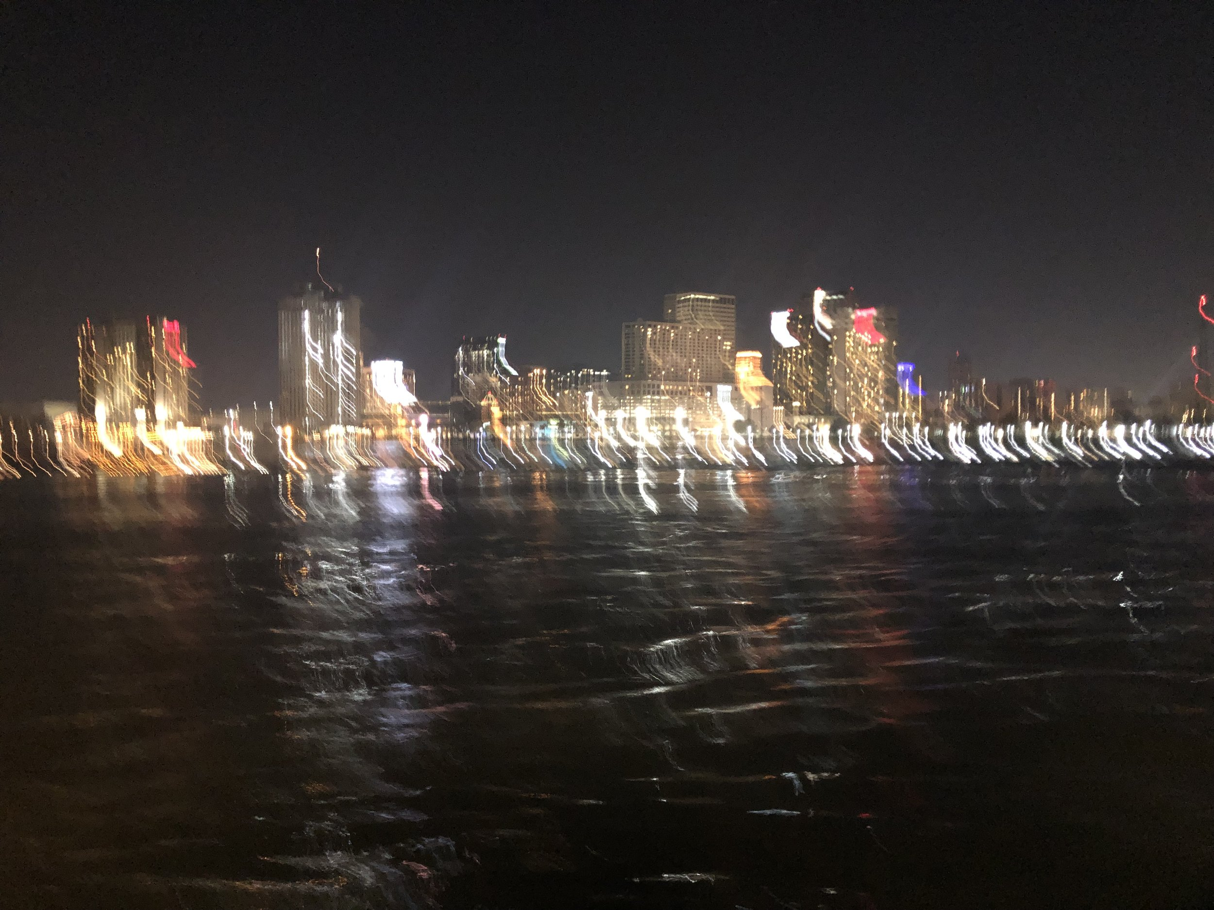 blurry photo of Nighttime New Orleans, taken from the Ferry returning from Algiers.