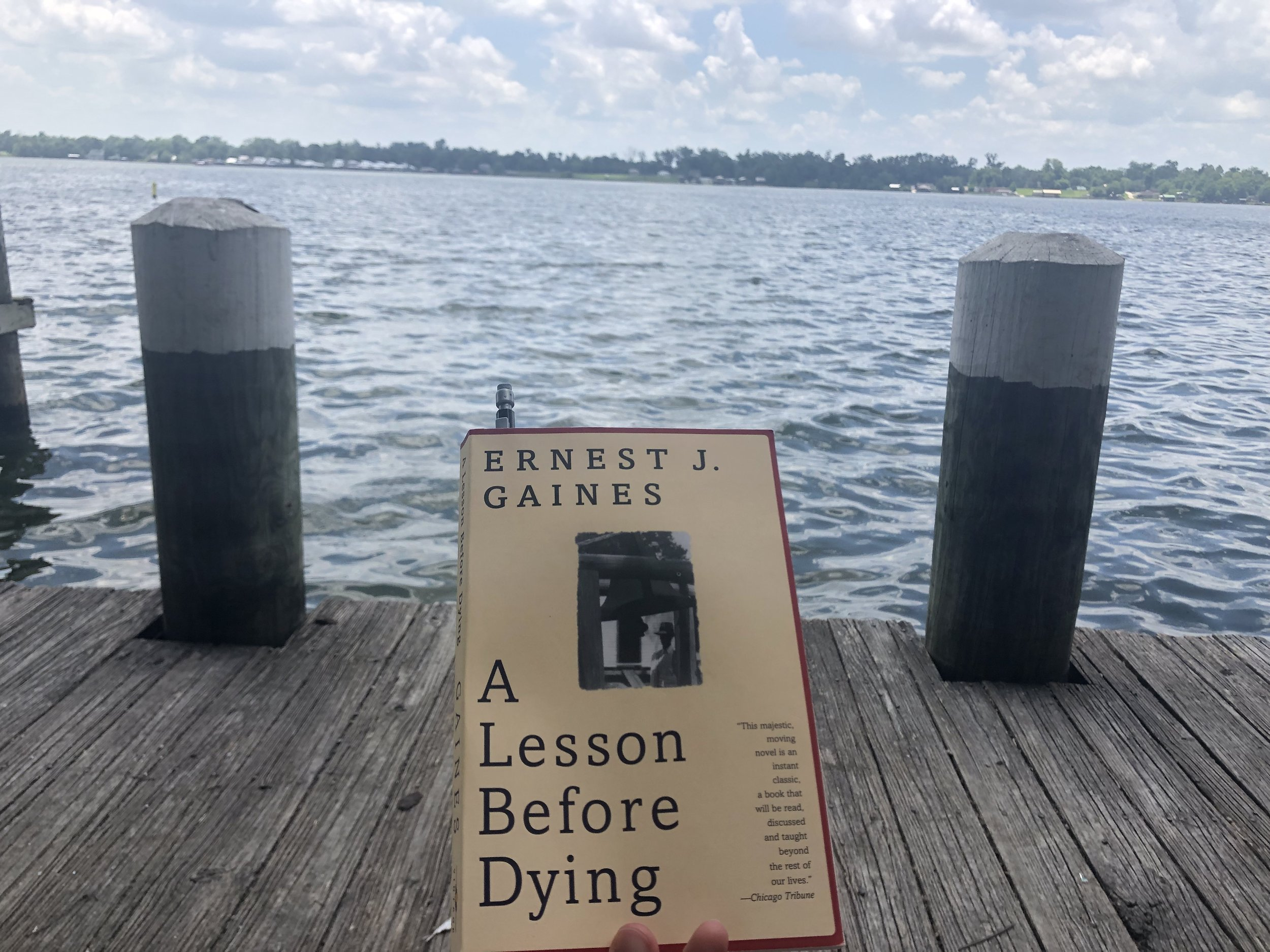 Reading A Lesson Before Dying while sitting by the same river that author Ernest J. Gaines lives near.