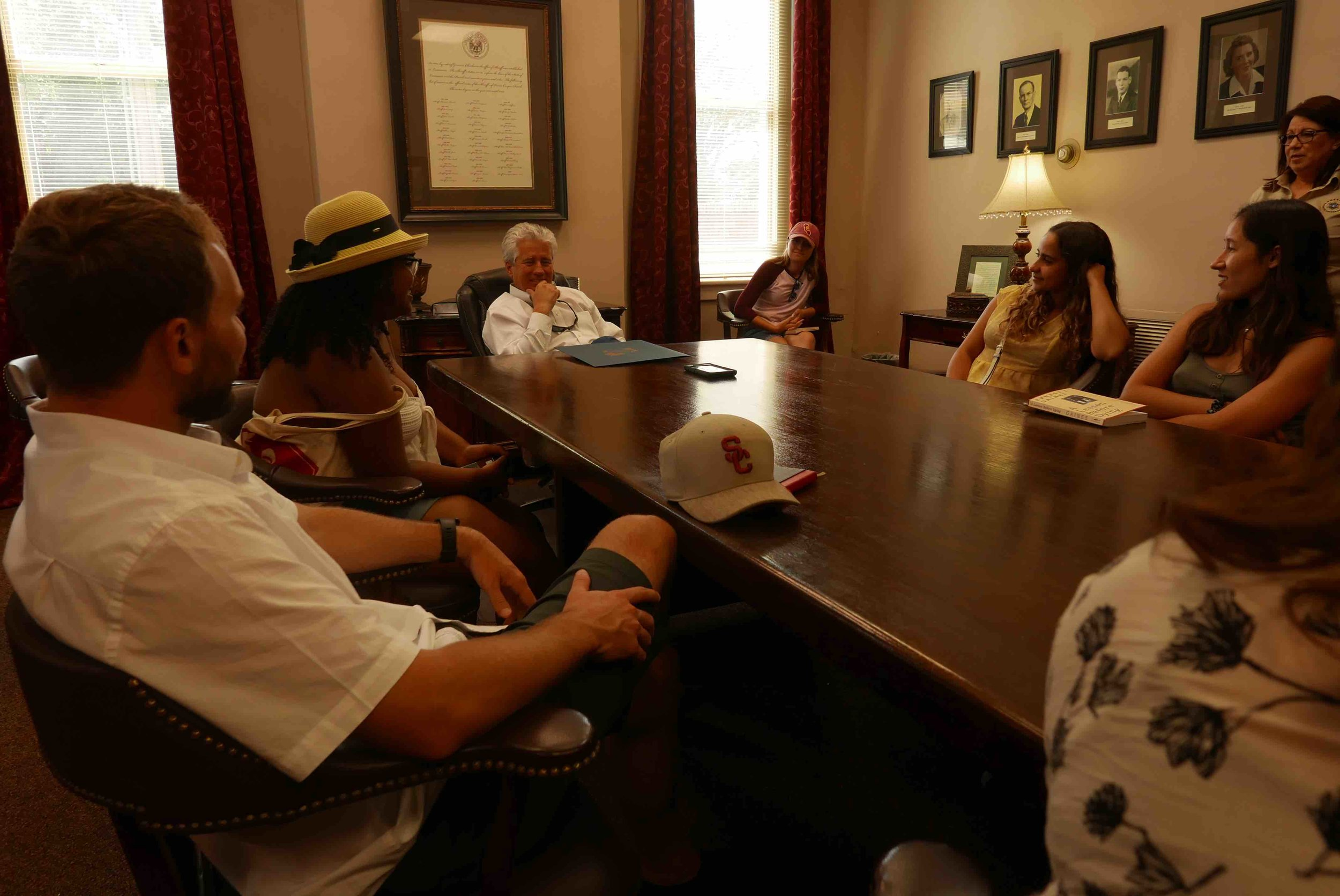 "Pictured at the head of the table is Sheriff Beauregard ""Bud"" Torres"