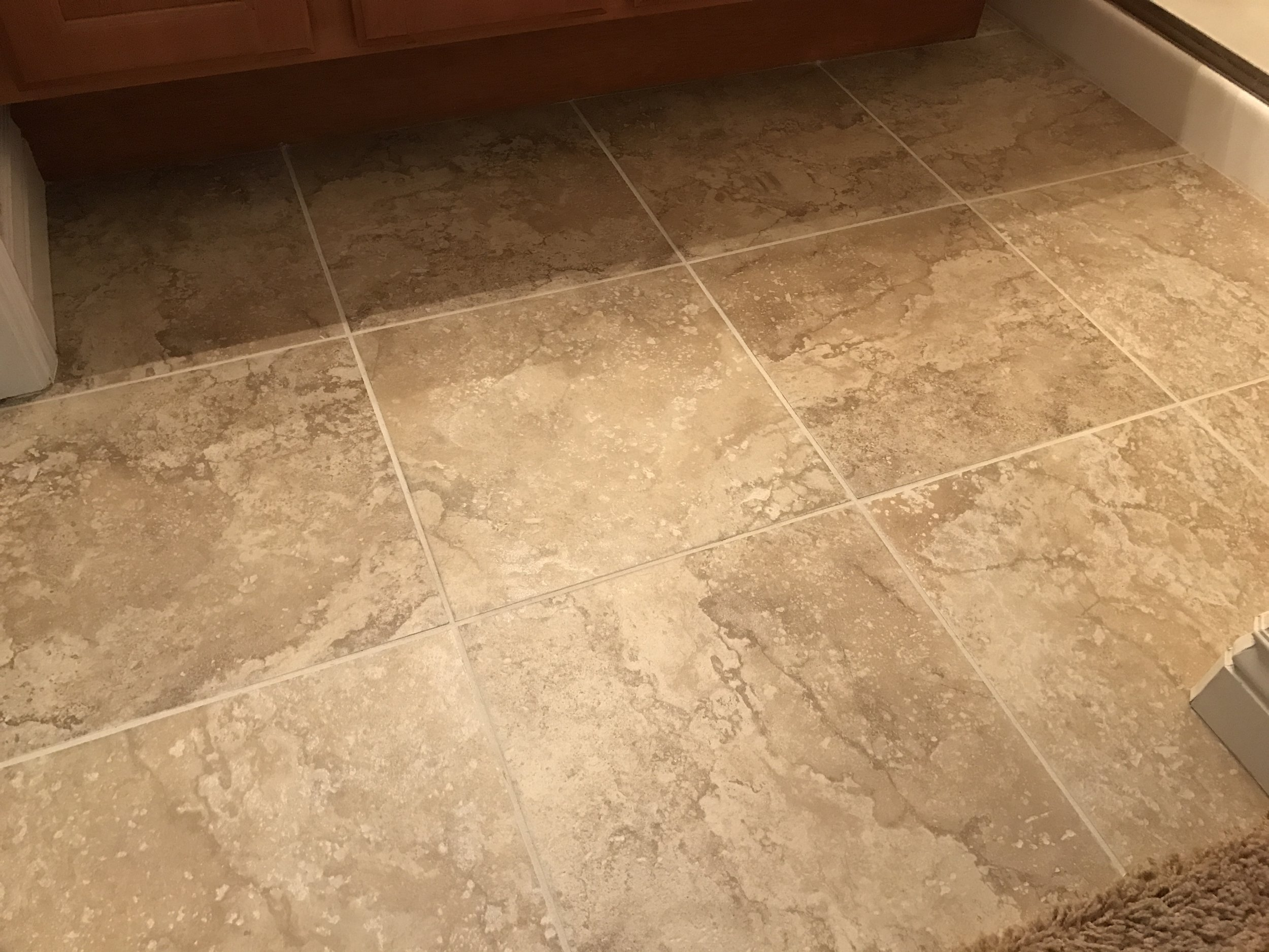 Floor cleaned and grout re-colored.