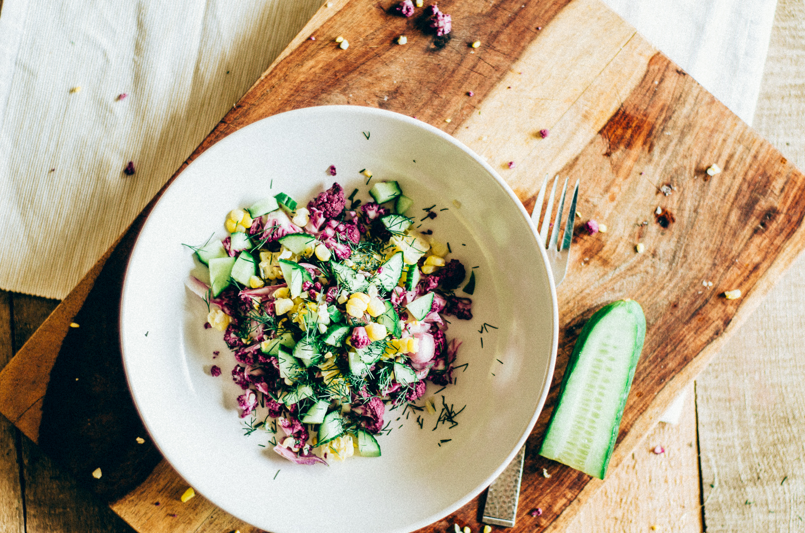 Cauliflower, Corn & Cucumber salad recipe is perfect for a fall harvest. It's a lovely vegetarian salad recipe. thenomadicwife.com