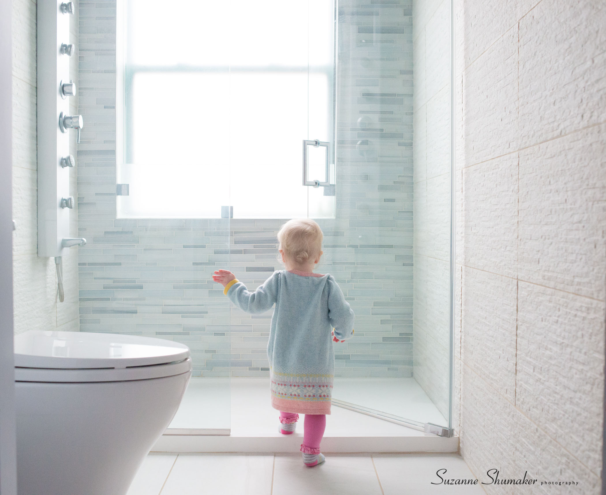 Checking out her Uncle's shower , love the modern shower pan with no curb.