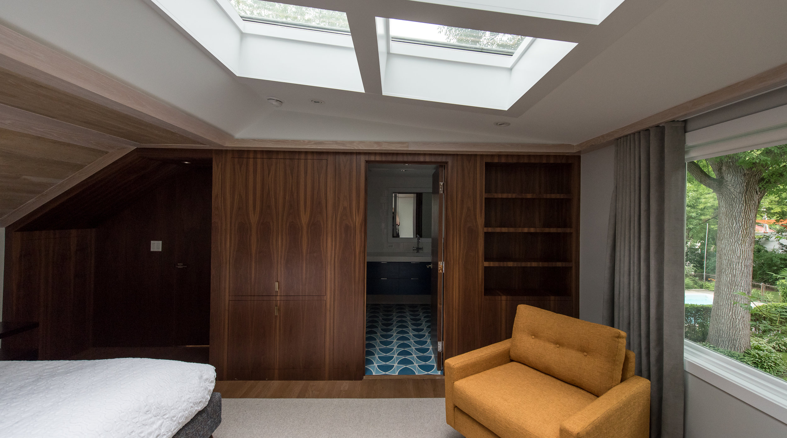 Master suite, Evanston IL. A attic in this mid-century modern split level was remodeled. New, larger windows and skylights added.