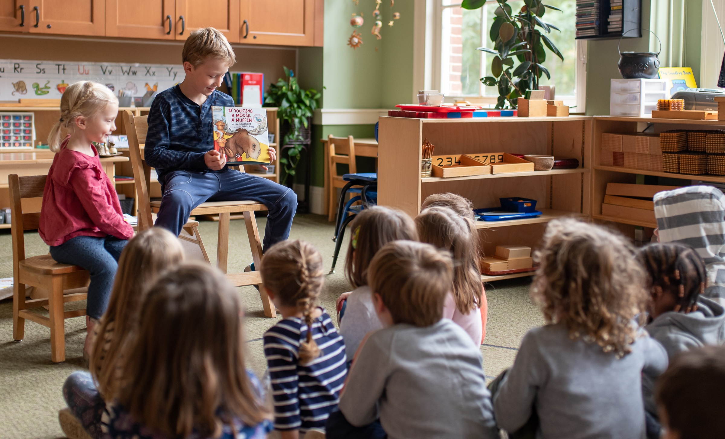 "Nick as ""mystery reader"" in Greta's early childhood class."