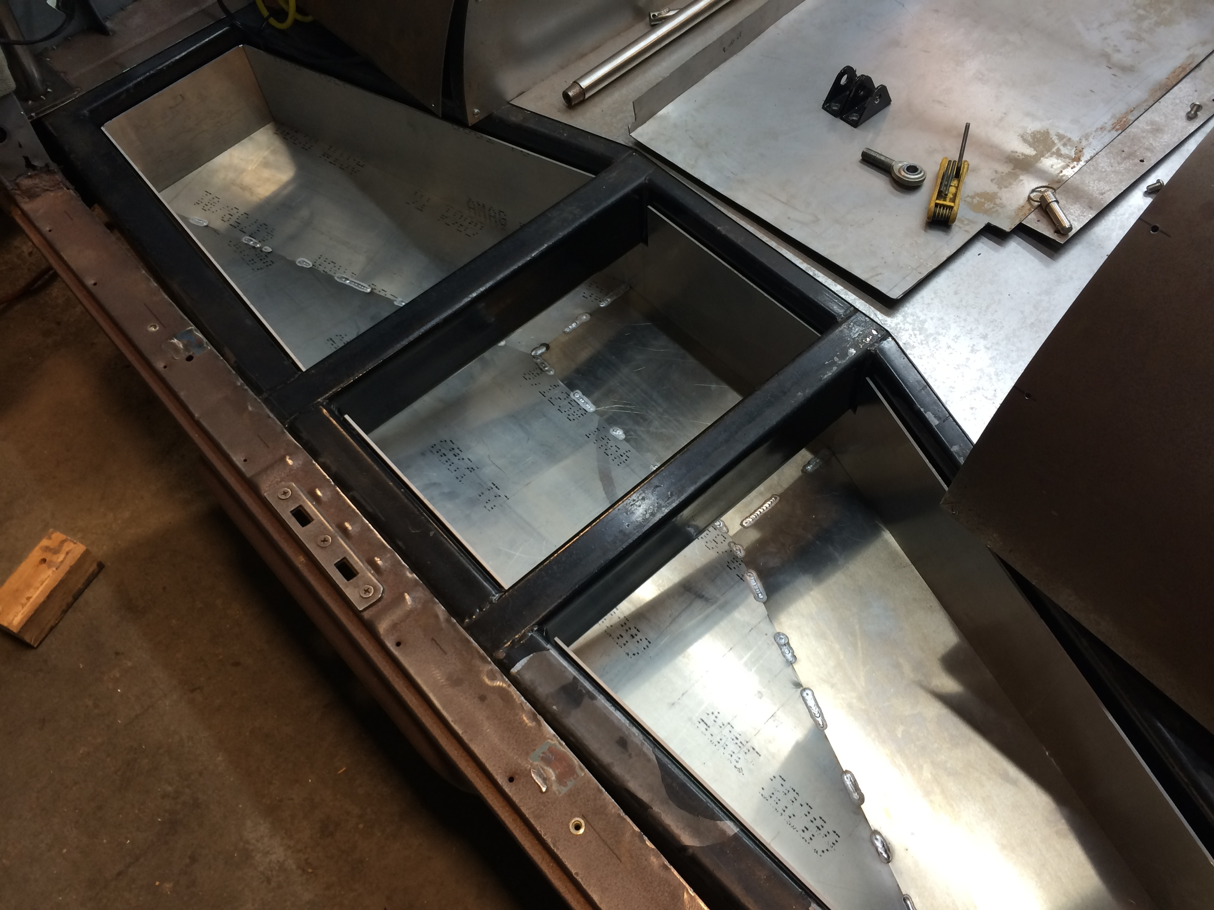 The first item I tackled once the van was back was the fuel tank. Intricately design to hold 15 gallons of fuel and fit within the van's unique frame. Made from welded waterjet cut aluminum plate.