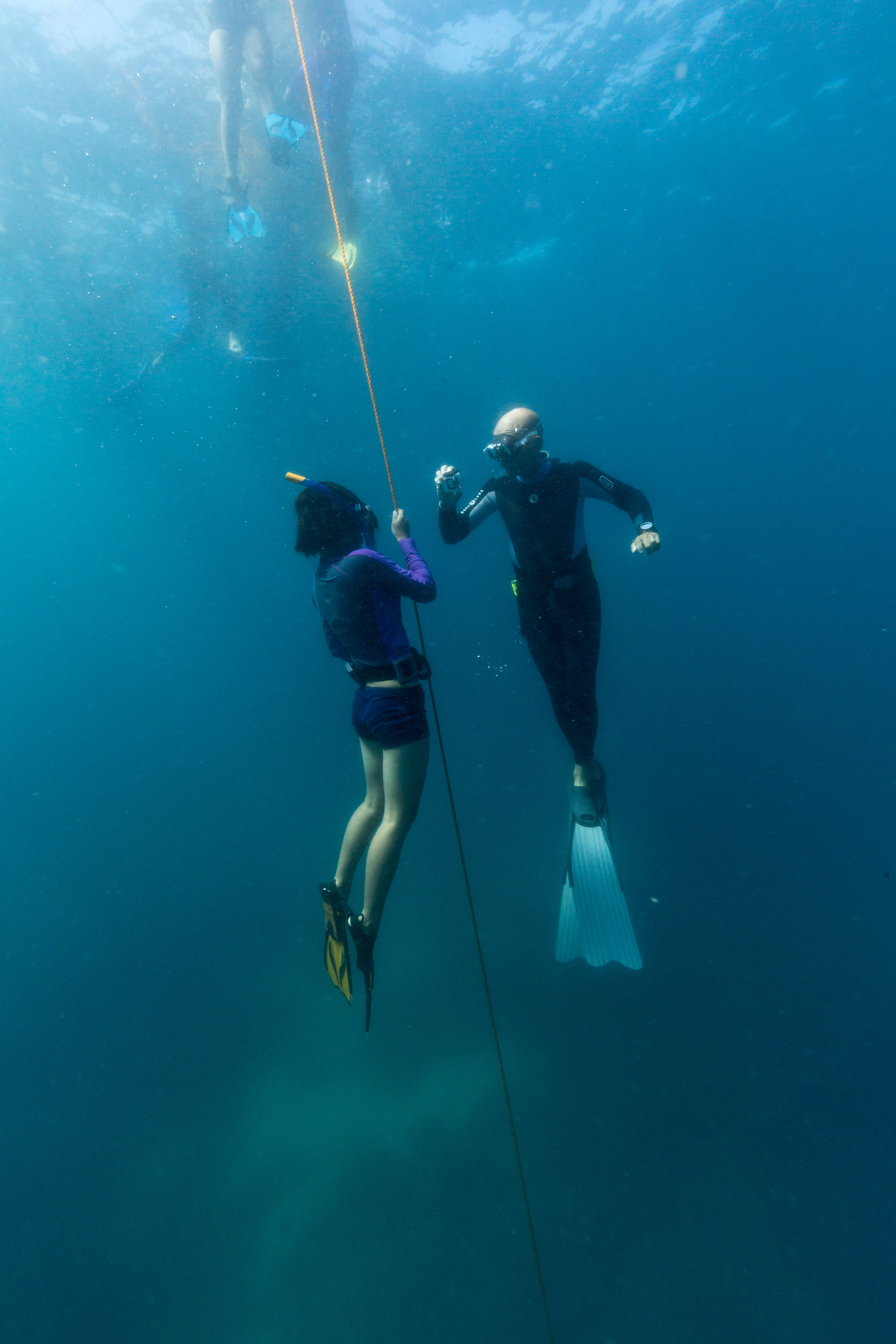 Mary Jean learning how to free dive, Apo Island, Philippines