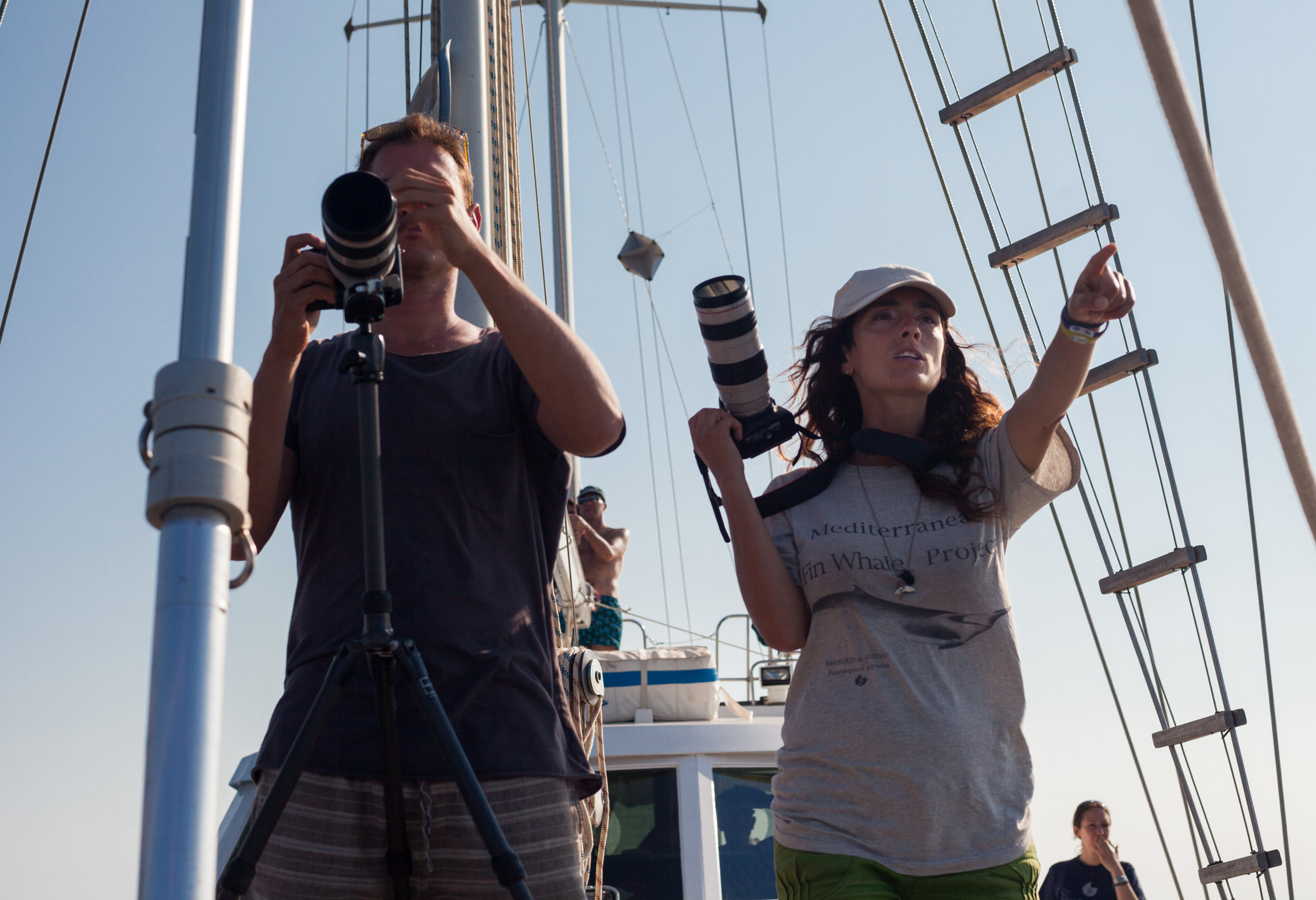Co-Director James Sherwood and Principal Field Investigator, Alessia Scuderi filming and photographing wildlife out in the Pelagos Sanctuary in the Mediterranean Sea.