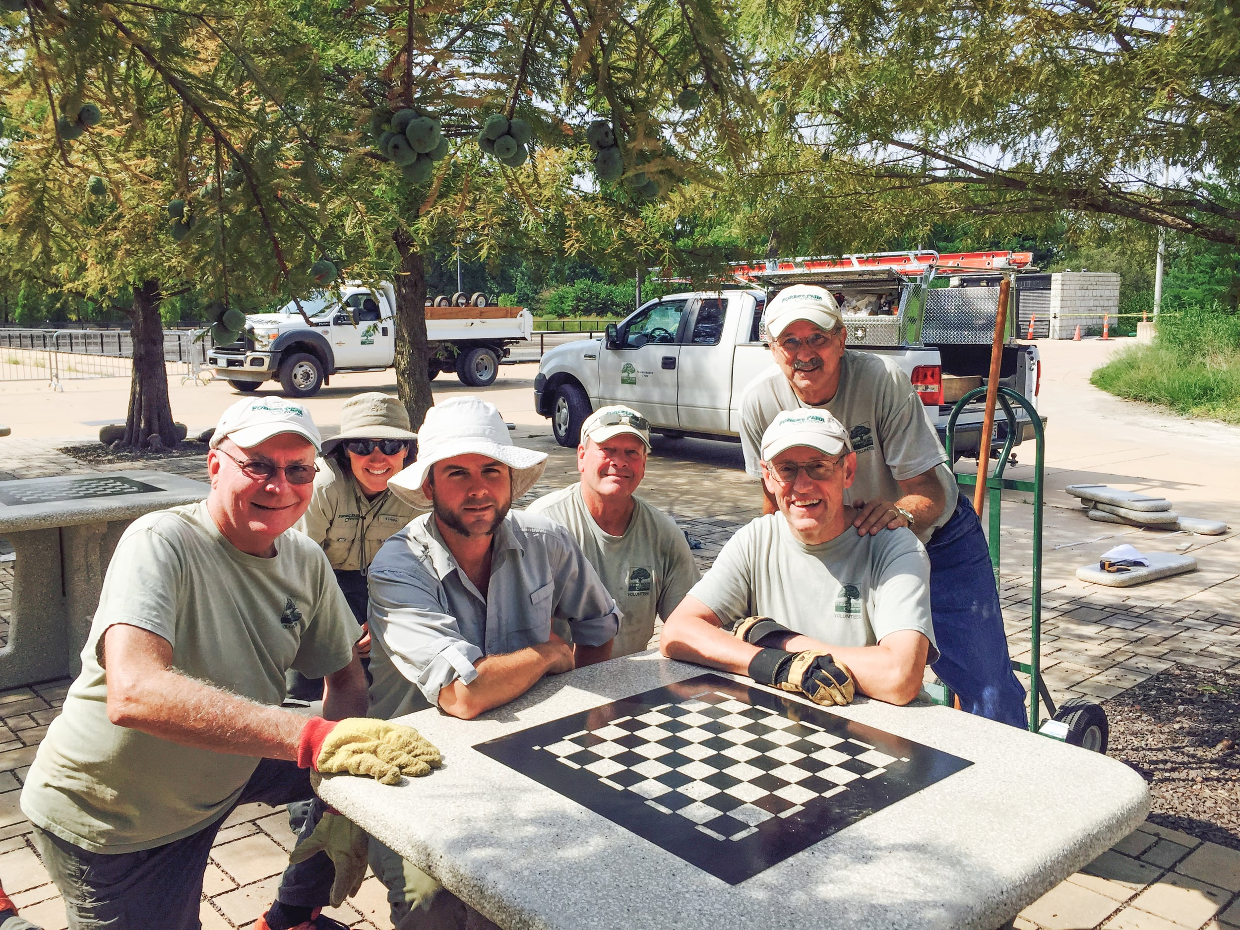 Helping install tables at the new chess plaza