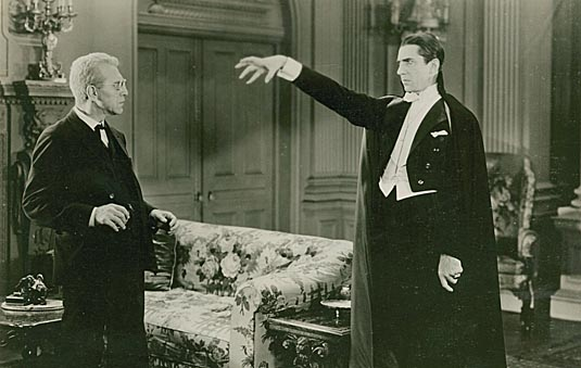 Van Helsing (Edward Van Sloan) confronts Dracula (Bela Lugosi).