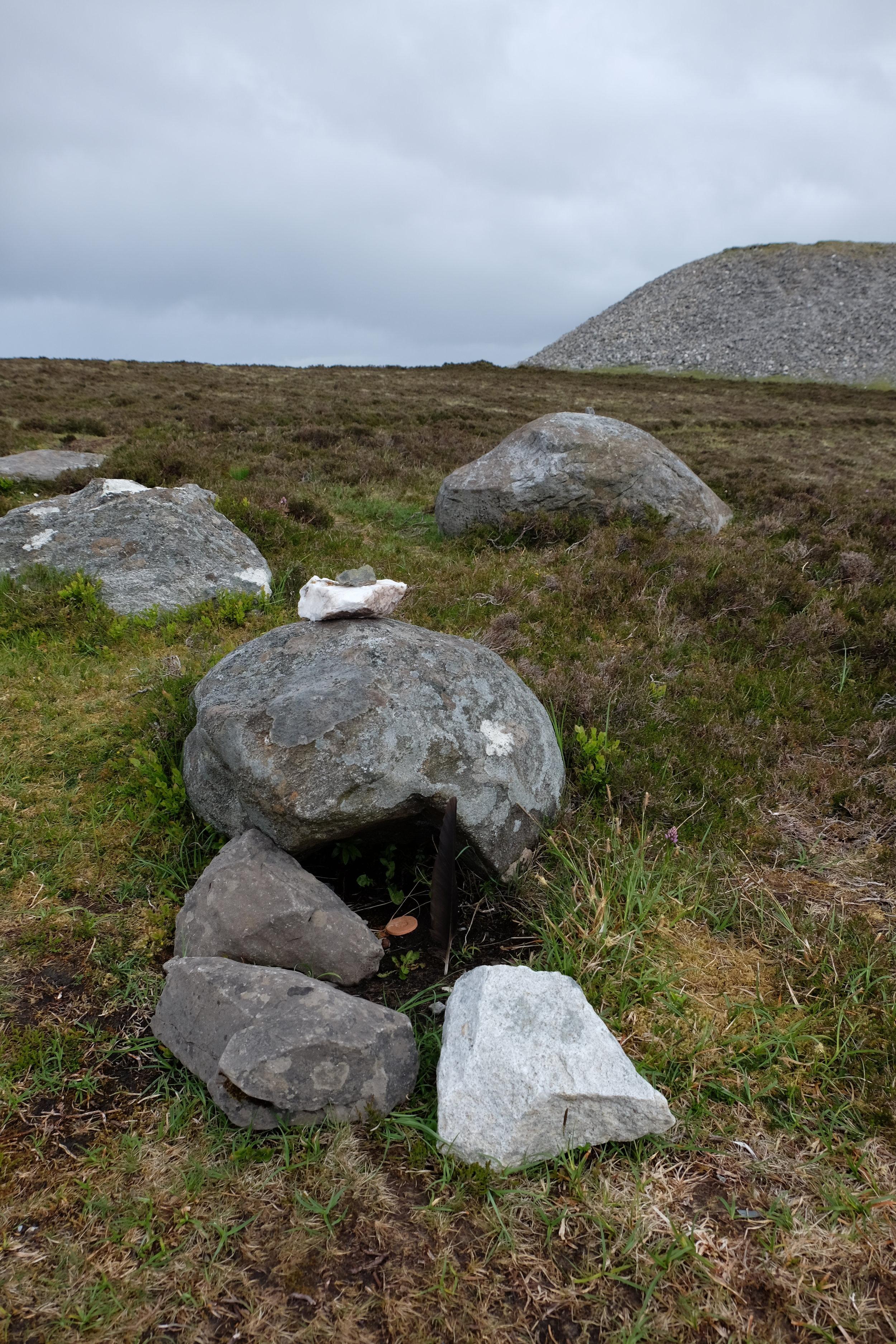 Queen Medb's cairn with offerings.