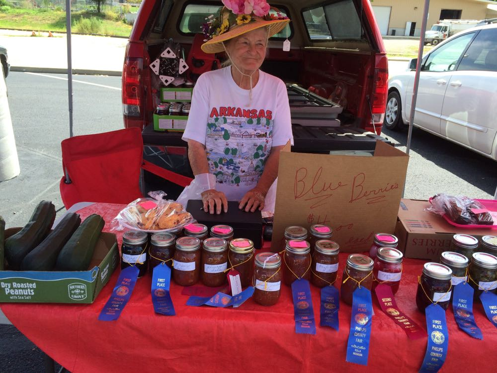 Laura at August 2, 2016 Rolla Farmer's Market, just after her ribbon haul from Phelps County Fair.