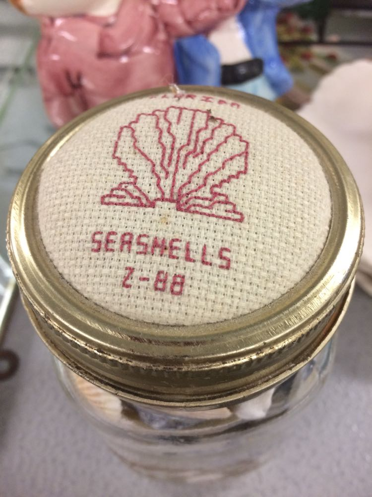 One way to decorate a food jar, use counted cross stitch top with makers initials for pincushion.