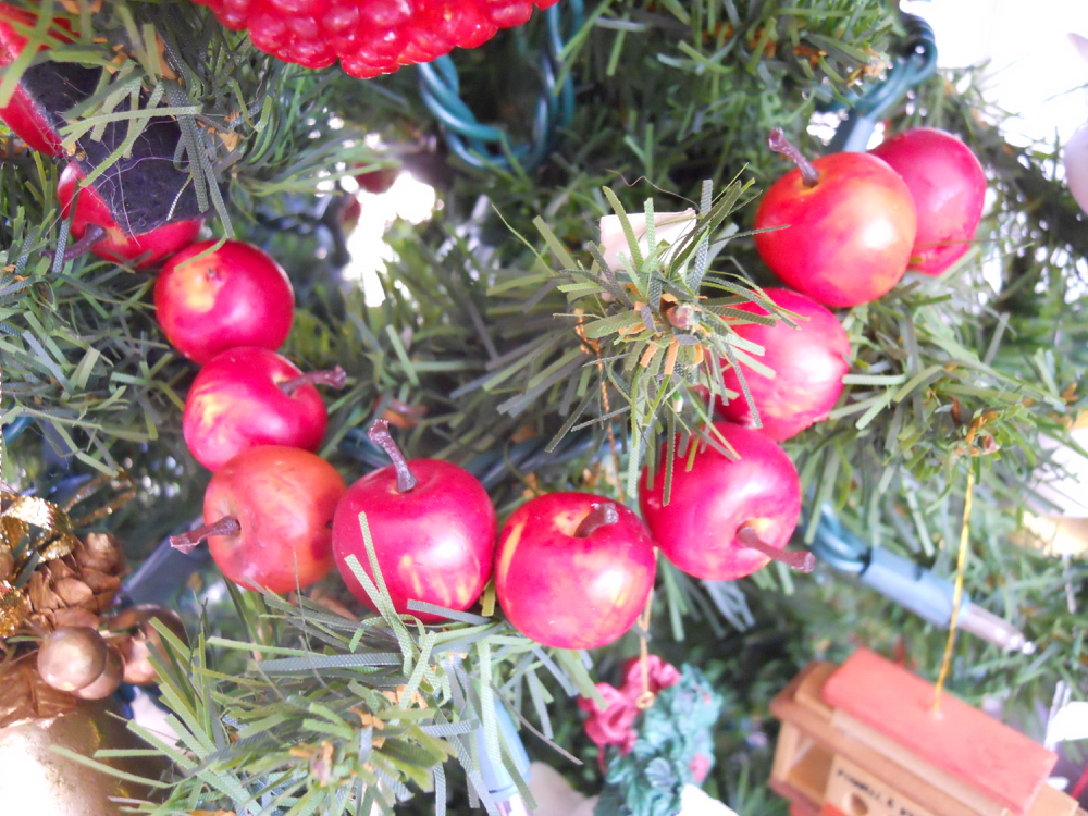 Fake cherry garland adds a nice pop of red in my Christmas tree.