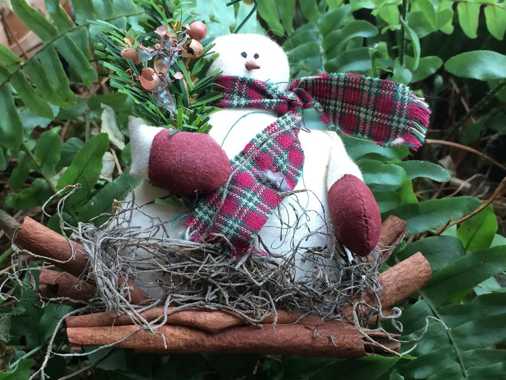 Snowman holiday winter decoration features a 4-inch fleece snowman on cinnamon stick.s